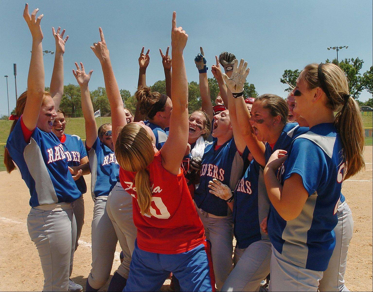 Glenbard South celebrates with coach Julie Fonda after an 11-1 victory in six innings over Mattoon in the Class 3A state semifinals Friday in East Peoria.