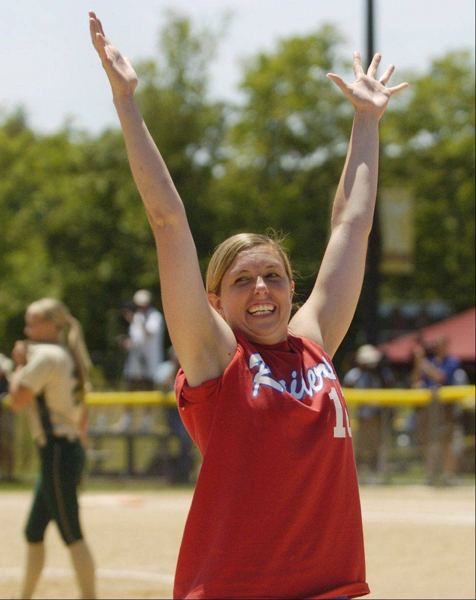 Coach Julie Fonda gestures to the crowd after a game-breaking homer by Jane Trzaska in the fourth inning during the Raiders' Class 3A state softball semifinal win over Mattoon.
