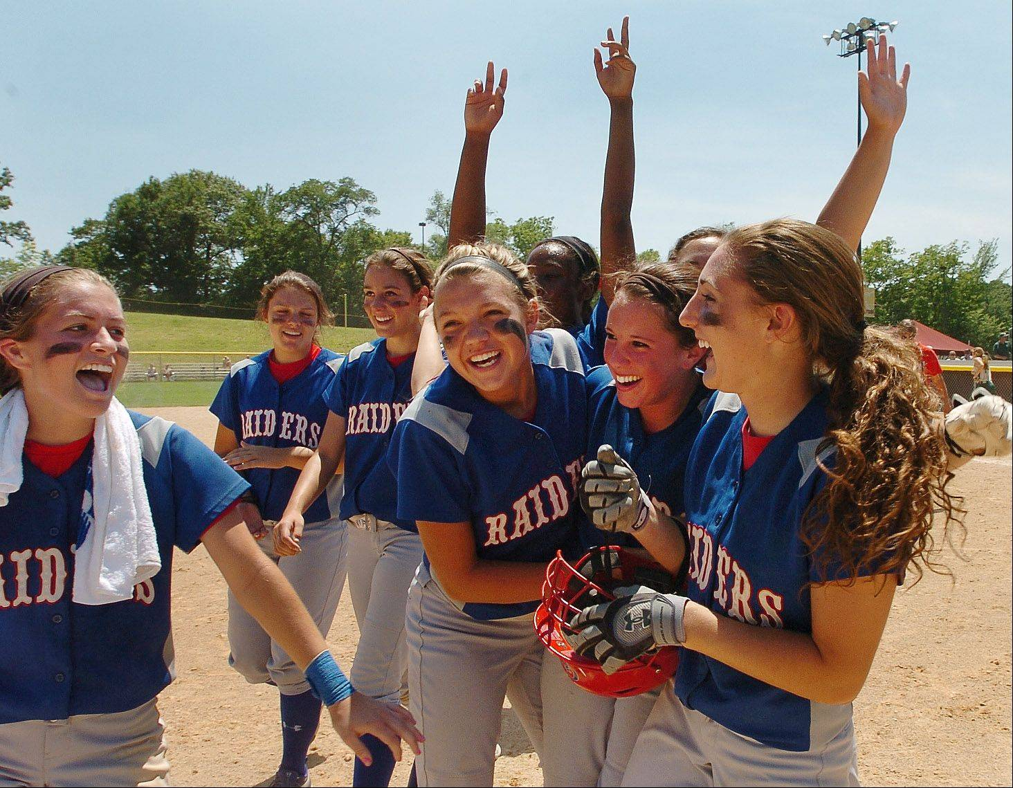 Glenbard South celebrates after its Class 3A state semifinal win over Mattoon.