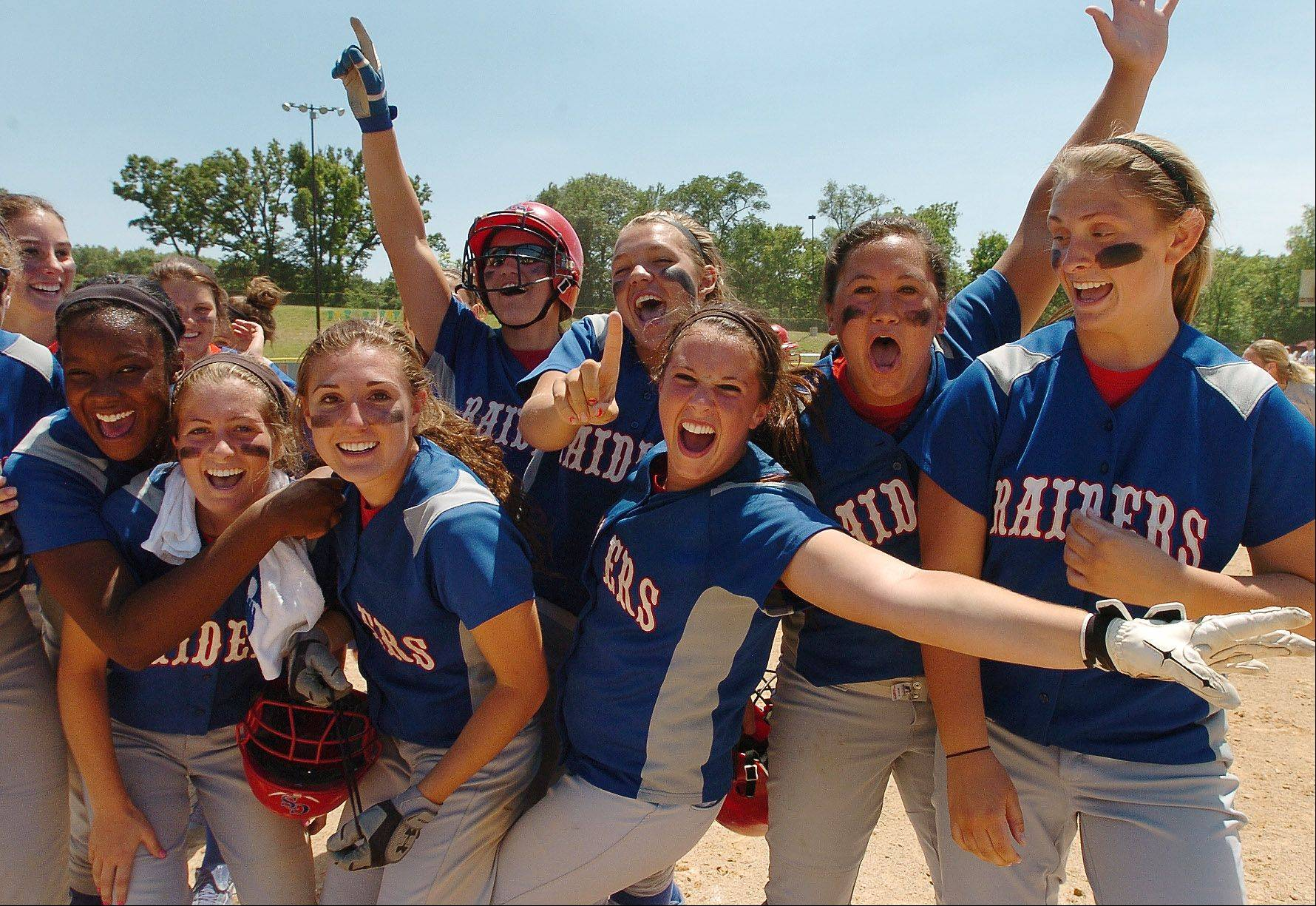 Glenbard South celebrates after its Class 3A softball state semifinal victory over Mattoon.