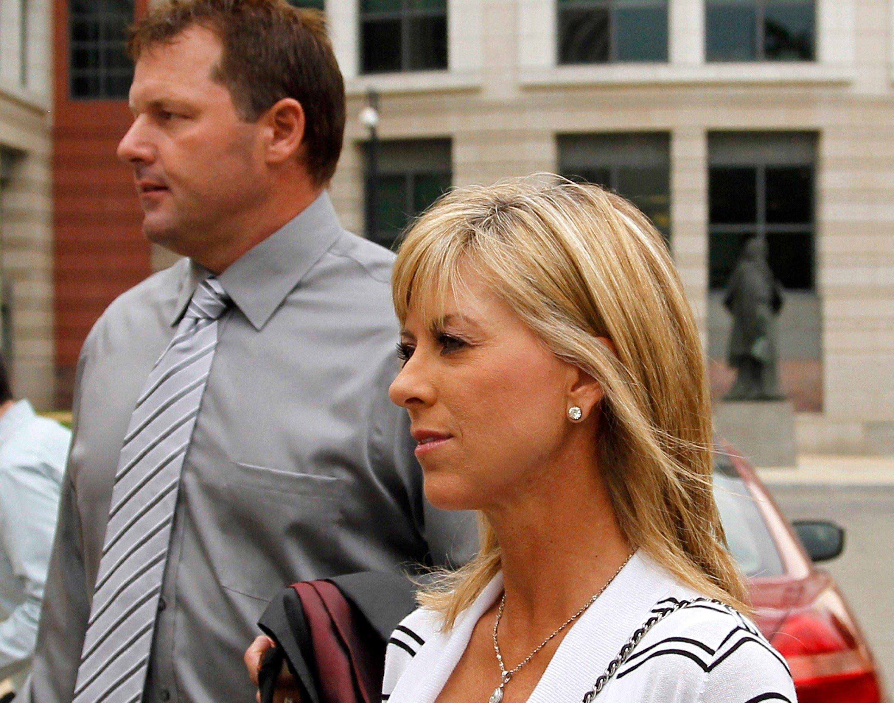 Debbie Clemens testified Friday that her husband, Roger Clemens, was not present when she received a shot of human growth hormone from Clemens' strength coach -- testimony that contradicts the star pitcher's chief accuser in the perjury trial.