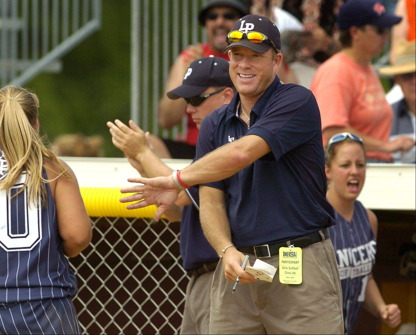 Cray Allen, here coaching Lake Park in the 2005 high school softball state quarterfinals, is Harper College's new coach.