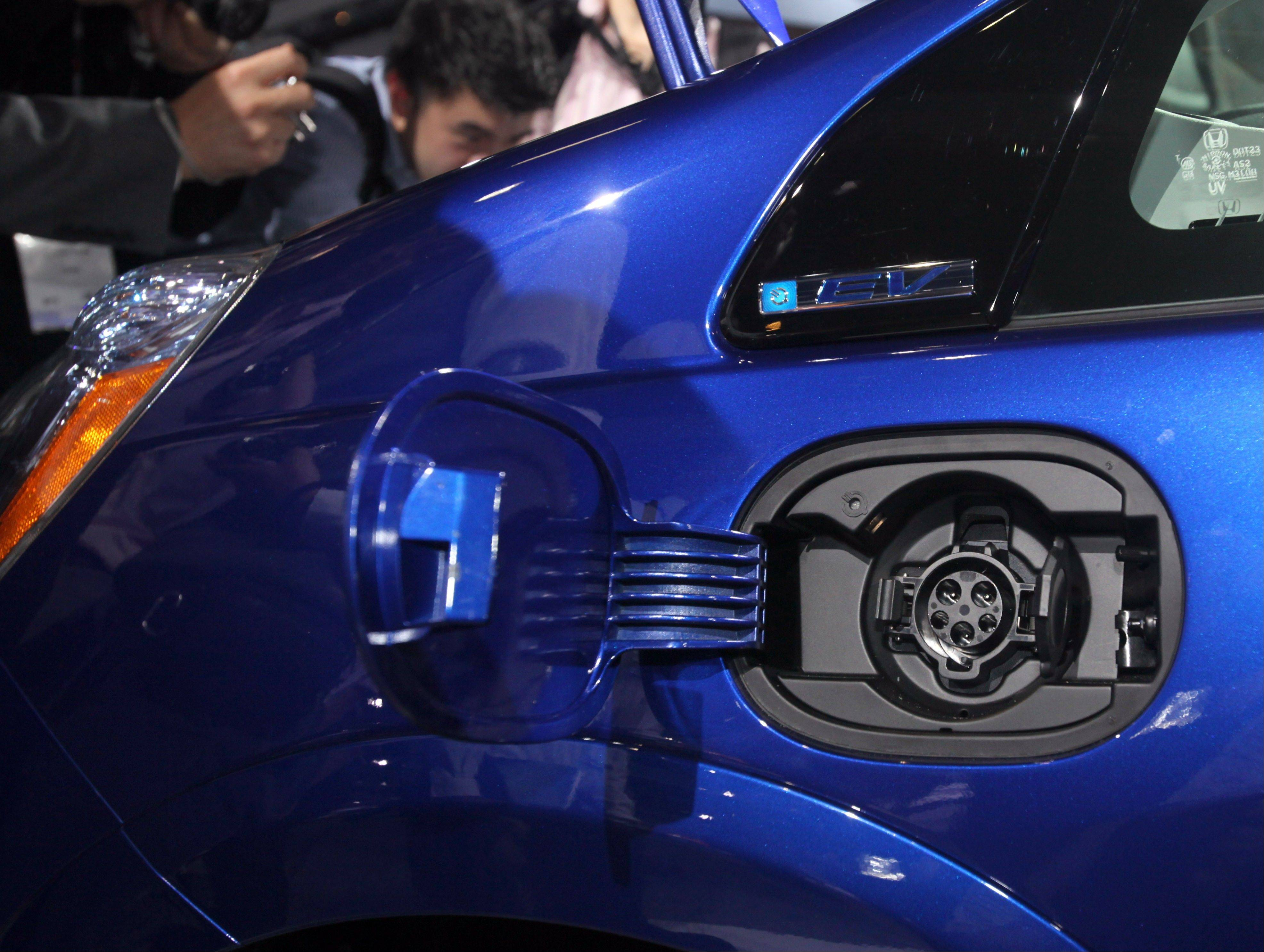 The charging port on the new all-electric 2013 Honda Fit EV is seen during its debut at the Los Angeles Auto Show, in Los Angeles. Honda said Wednesday that the 2013 Fit EV has received the highest fuel efficiency rating ever from the Environmental Protection Agency.