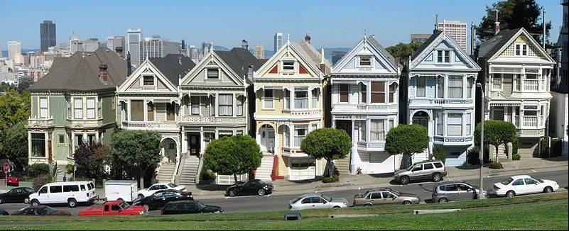 At least 100 tour buses a day stop at the Victorian houses in San Francisco's Alamo Square neighborhood.