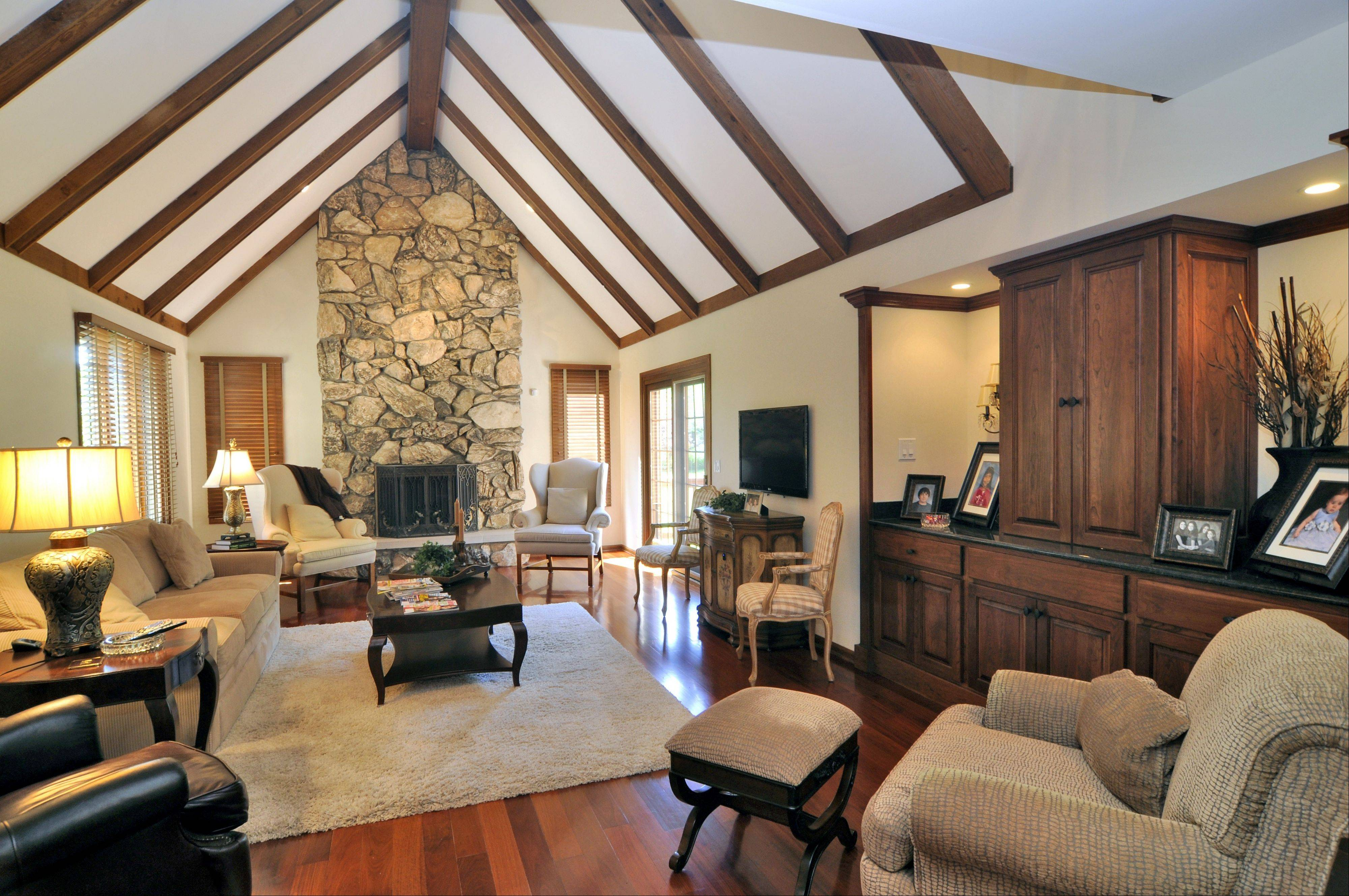 The family room features Brazilian cherry floors, a large stone fireplace and vaulted ceiling.