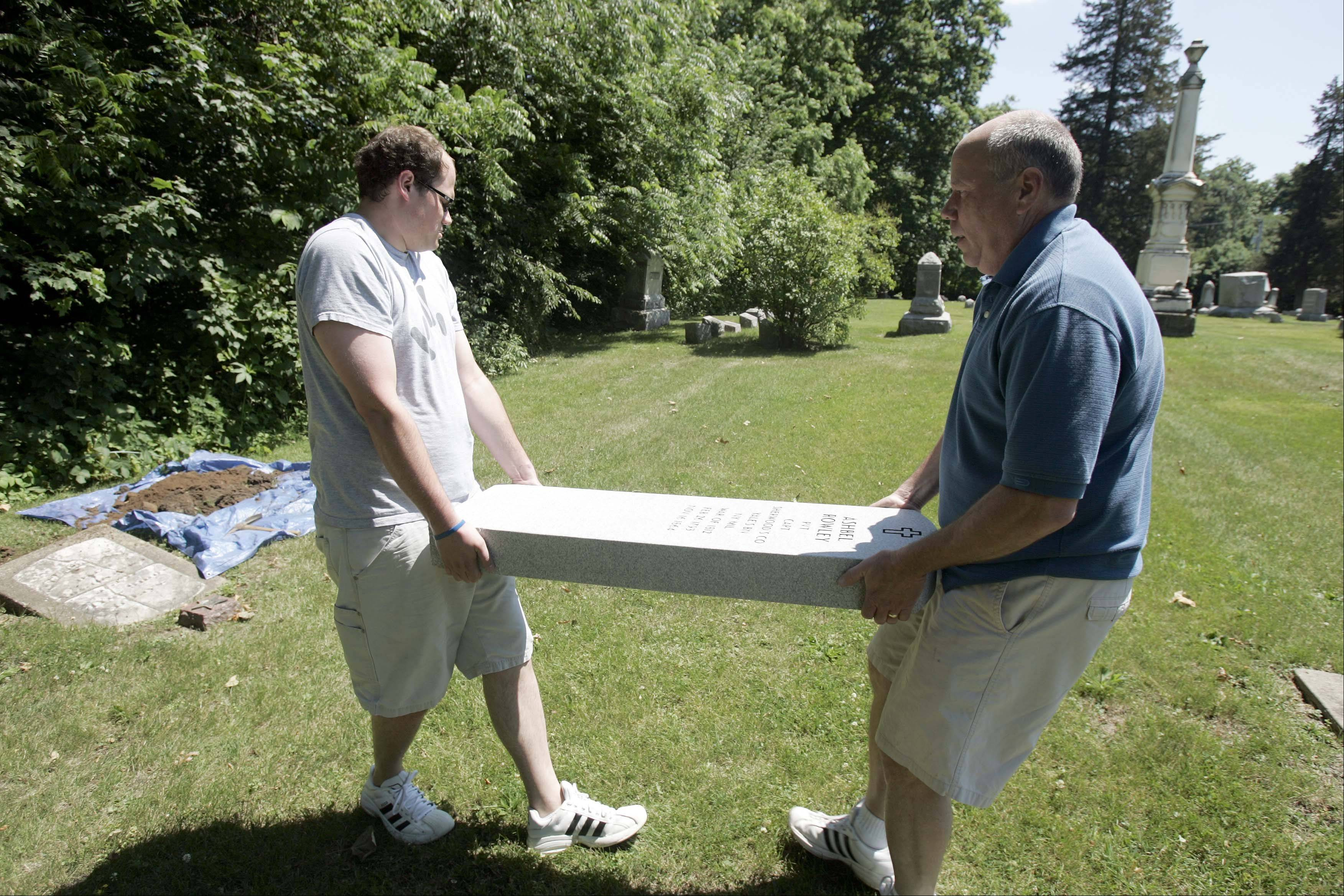 Mike Rowley, right, and his son, Tim, came from Iowa Thursday to replace the gravestone of an ancestor at the Sugar Grove Cemetery. Their third and fourth great grandfather Ashbel Rowley, respectively, was in the war of 1812. The 200th anniversary of the War of 1812 is June 18.