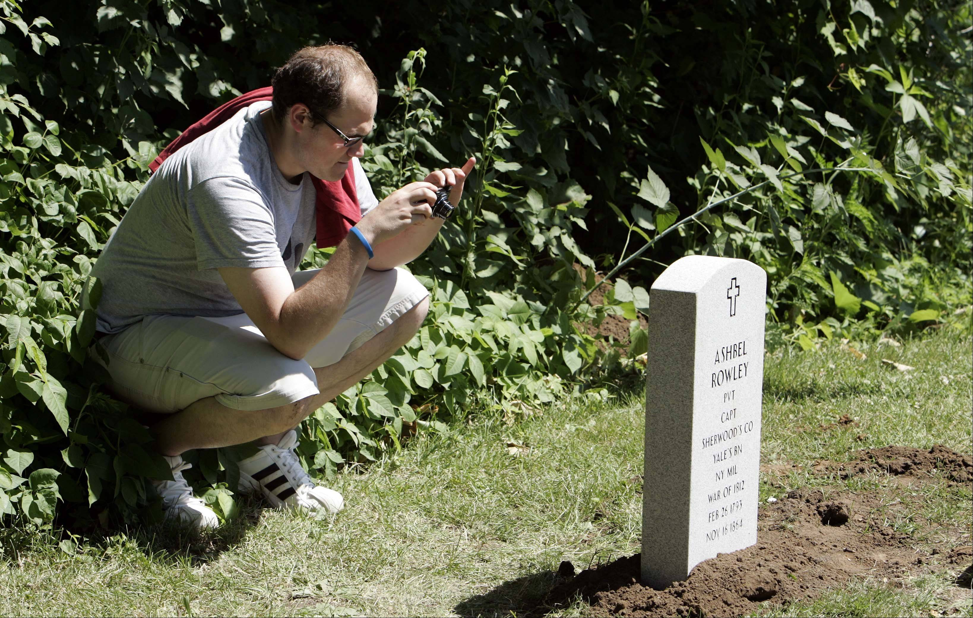 Tim Rowley came from Iowa Thursday to replace the gravestone of an ancestor at the Sugar Grove Cemetery.