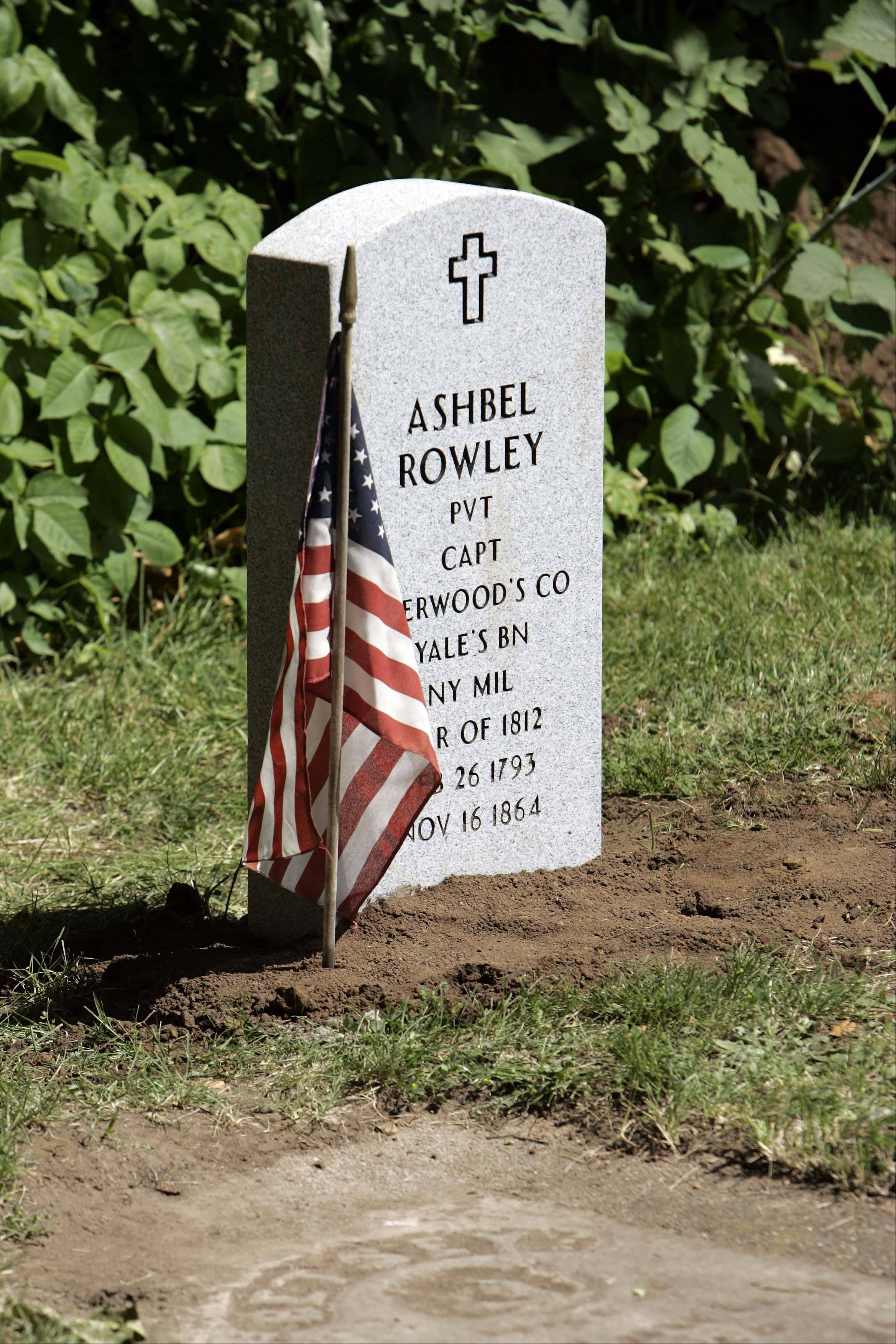Complete with a flag, the new gravestone of Ashbel Rowley sits in the Sugar Grove Cemetery.
