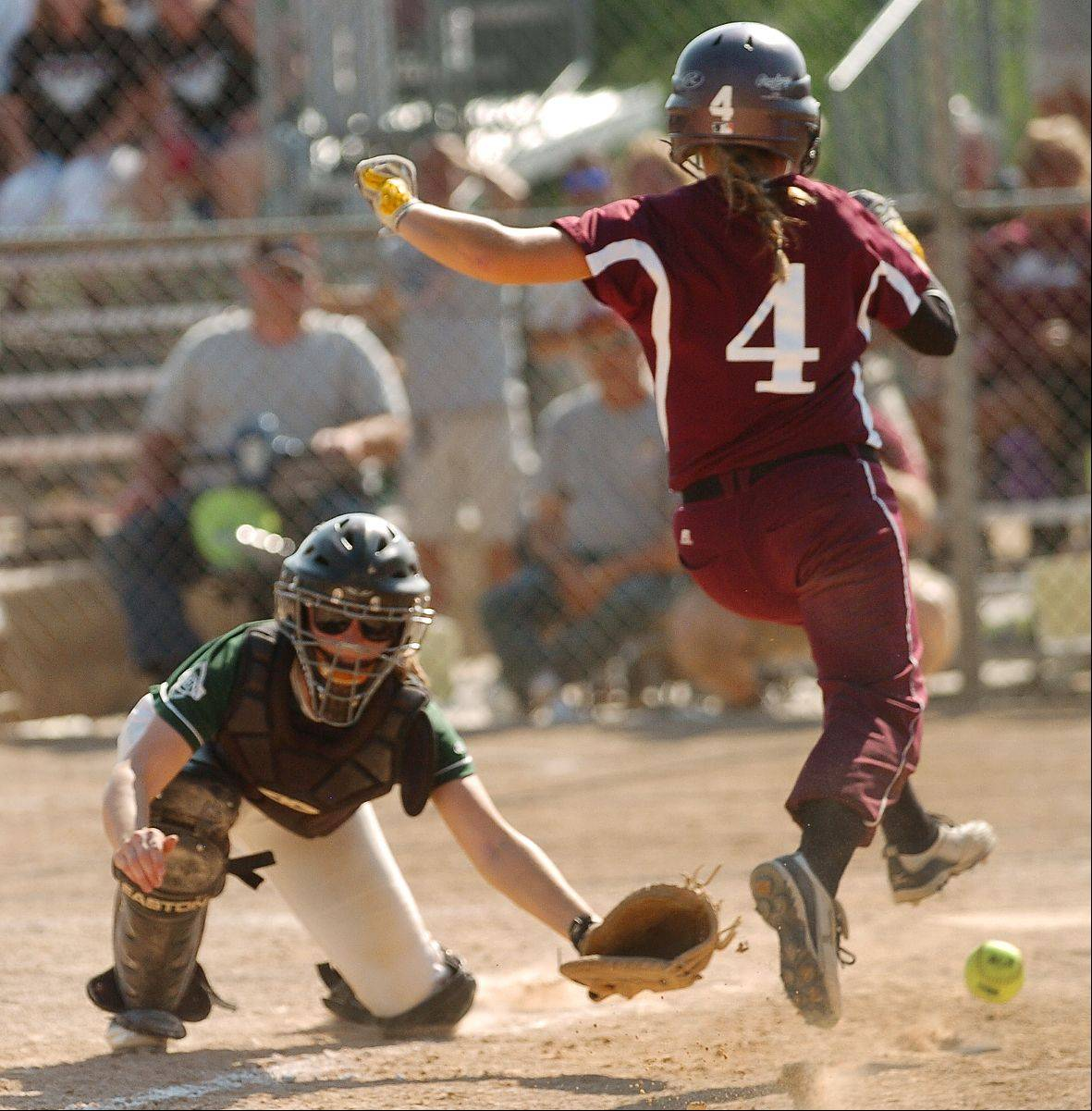 Elk Grove catcher Devin Parkison tries to tag Moline runner Emily Rache as she scores the go-ahead run in the eighth inning during the Class 4A softball third-place game.