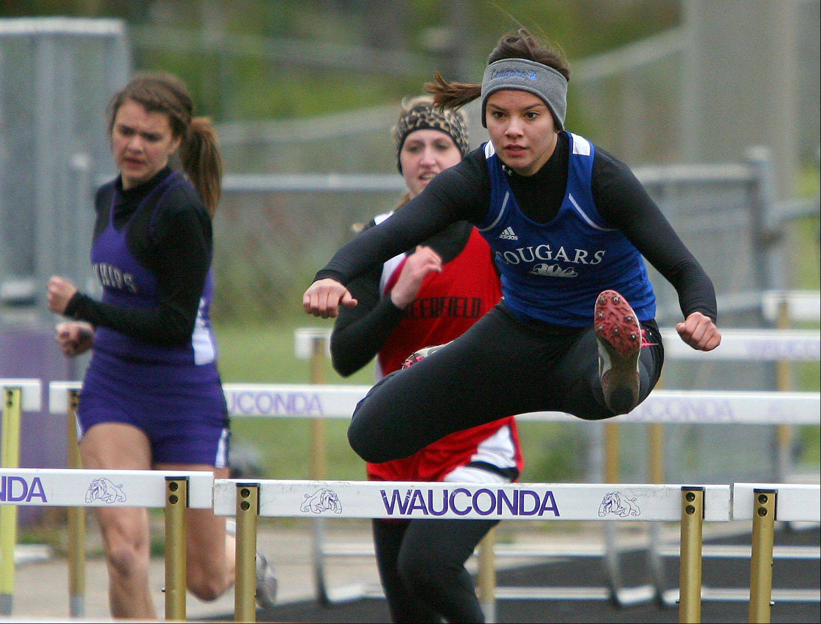 A stone-cold closer, Alli Tran leads the pack in the prelims of the 100-meter hurdles during Wauconda's invitational in April.