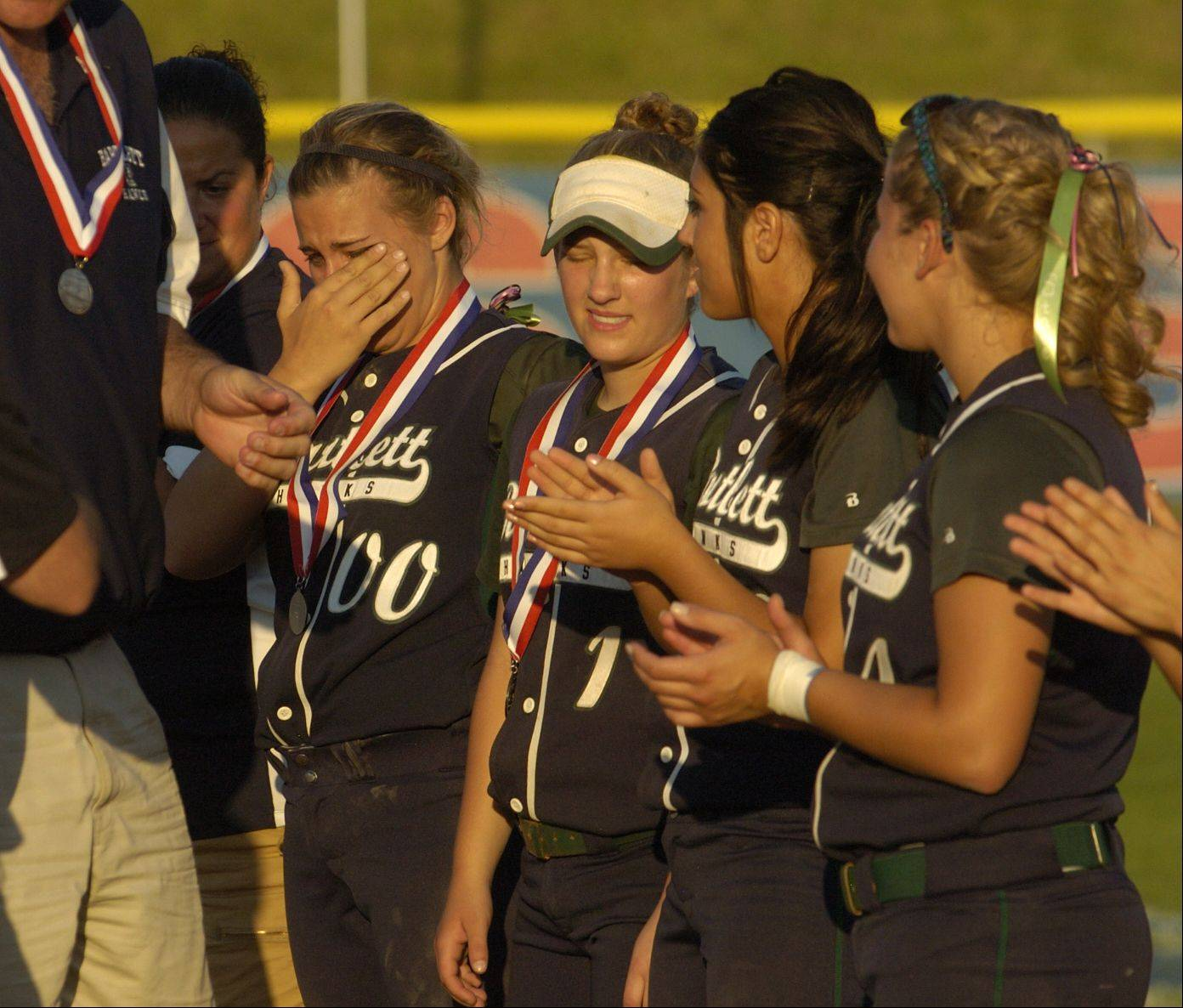 Bartlett receives its second-place medal after falling short against Marist in the Class 4A softball state championship game.