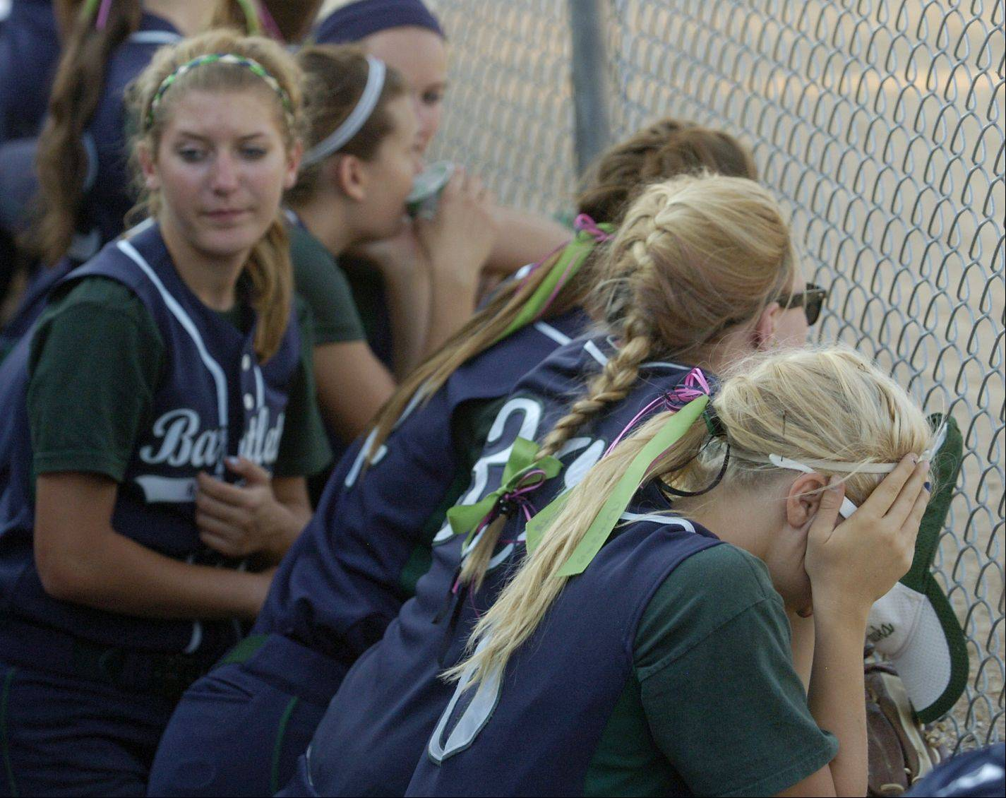 A dejected Bartlett bench reacts trailing by 5 runs late in the game against Marist in the Class 4A softball state championship game.