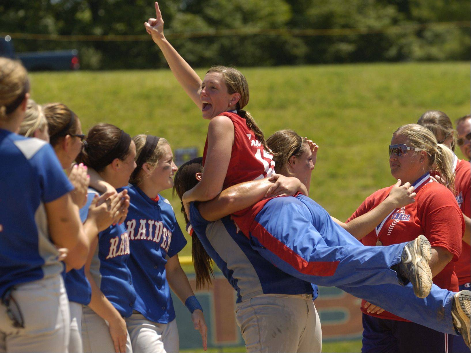 Coach Julie Fonda is lifted in the air after Glenbard South captures the Class 3A state softball title.