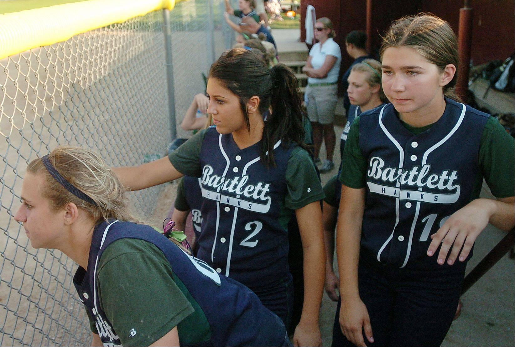 A glum Bartlett team watches the final out of their Class 4A state softball championship loss to Marist.