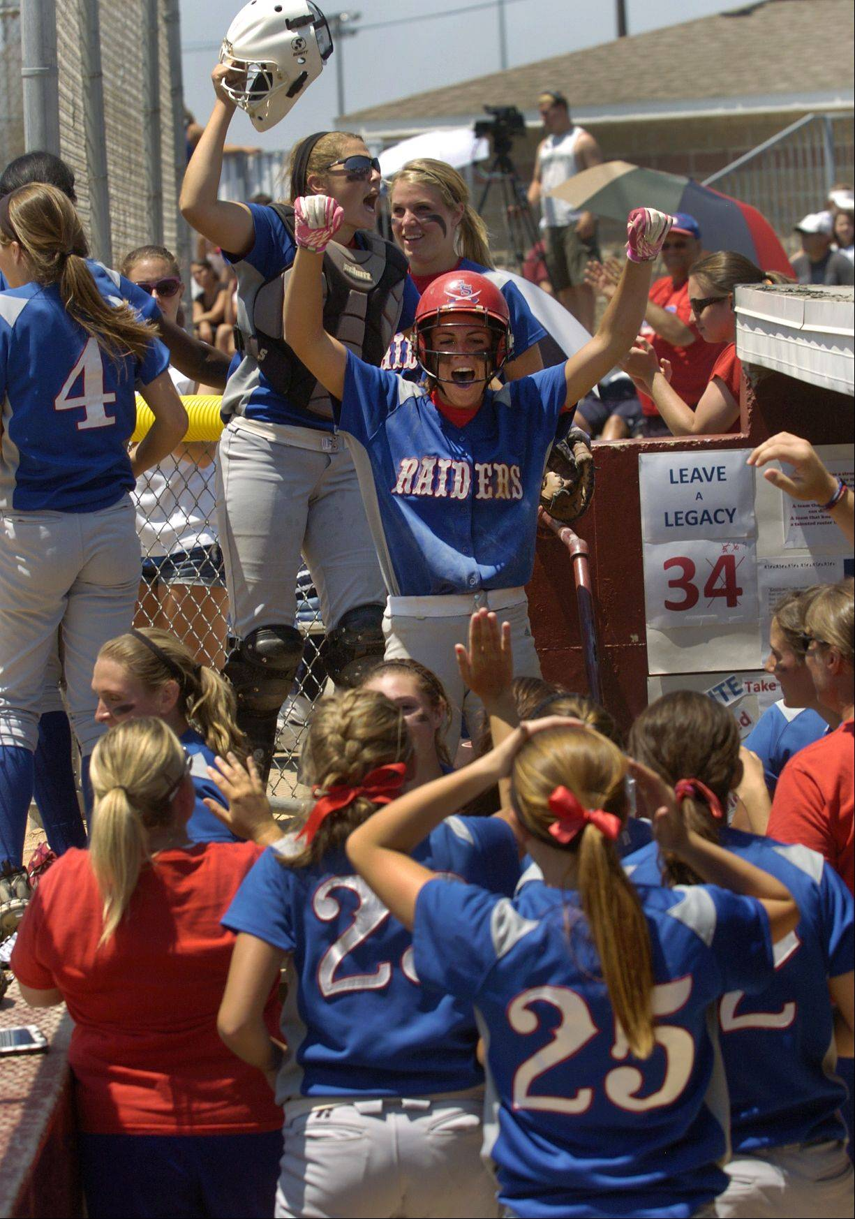 Glenbard South celebrates after putting 2 runs on the board in the 4th inning of the Class 3A state softball final.