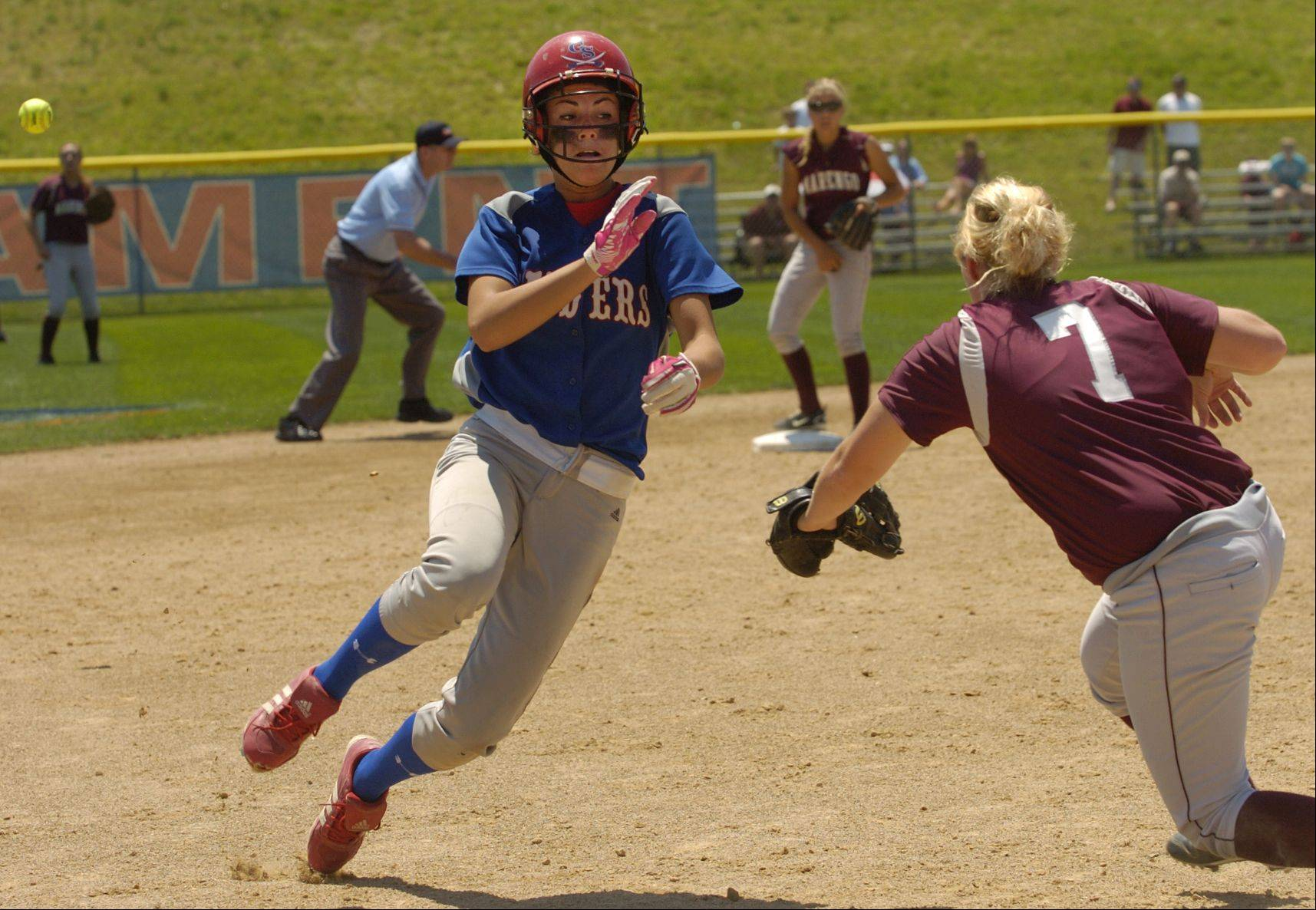 Danielle Chitkowski avoids a tag at third base later scoring the second run of the game during Class 3A state softball final between Marengo and Glenbard South.