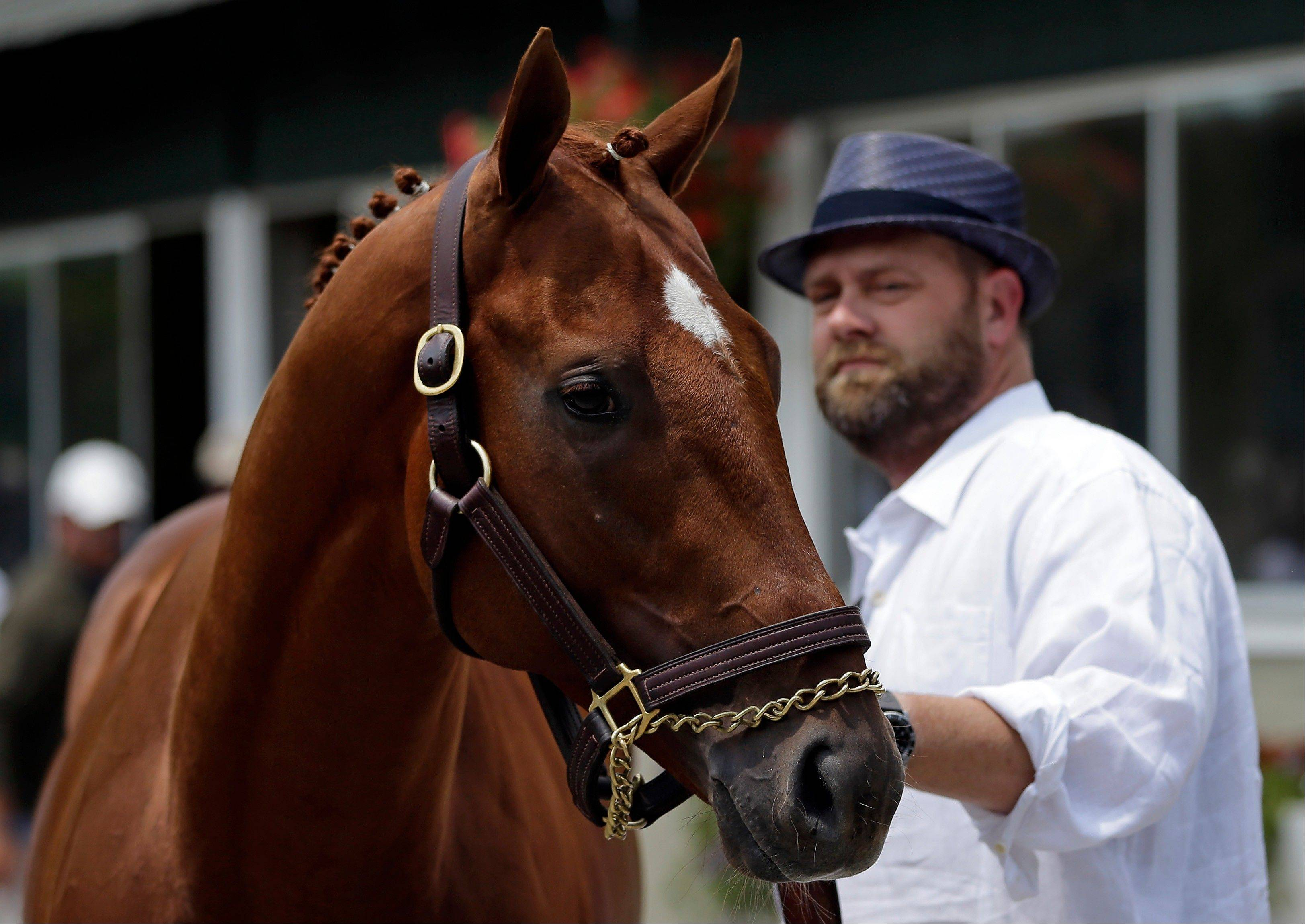 Kentucky Derby and Preakness winner I'll Have Another stands with trainer Doug O'Neill during a news conference at Belmont Park on Friday. Mike Imrem believes I'll Have Another was scratched from his shot at the Triple Crown for all the right reasons.