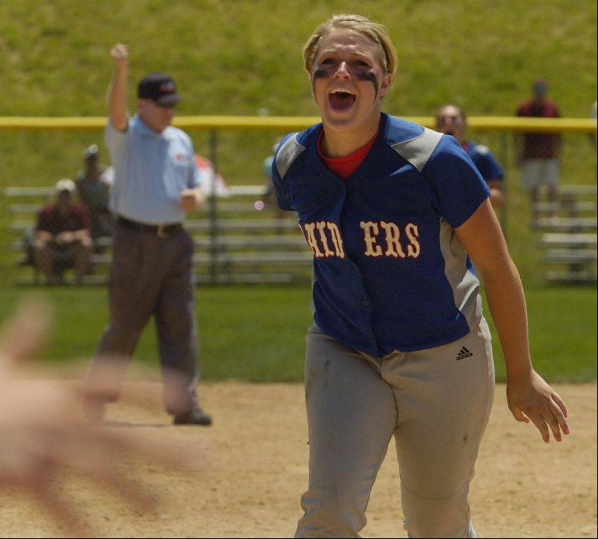 The umpire signals the final out as Glenbard South pitcher Stephanie Chitkowski celebrates a Class 3A softball state championship.