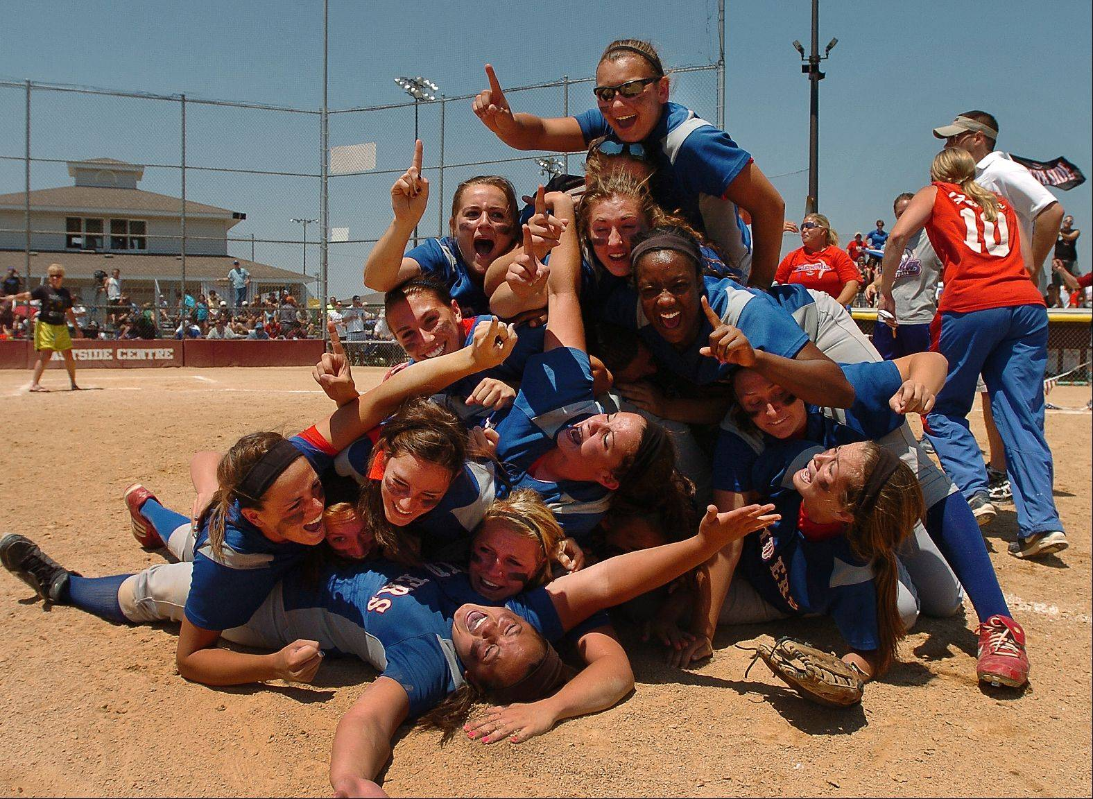 Glenbard South celebrates after winning the Class 3A state softball championship Saturday in East Peoria. The Raiders defeated defending champion Marengo 2-1.