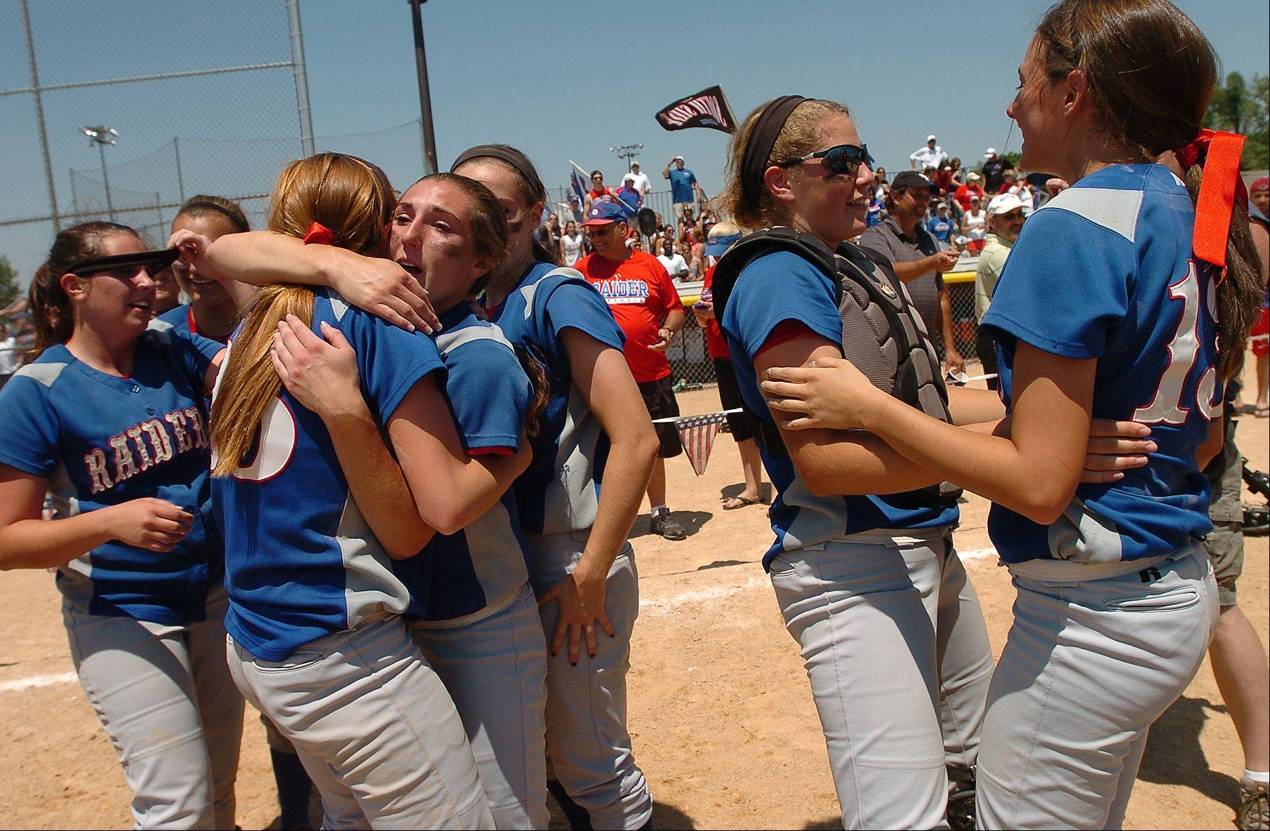 Glenbard South celebrates after capturing the Class 3A softball state championship.