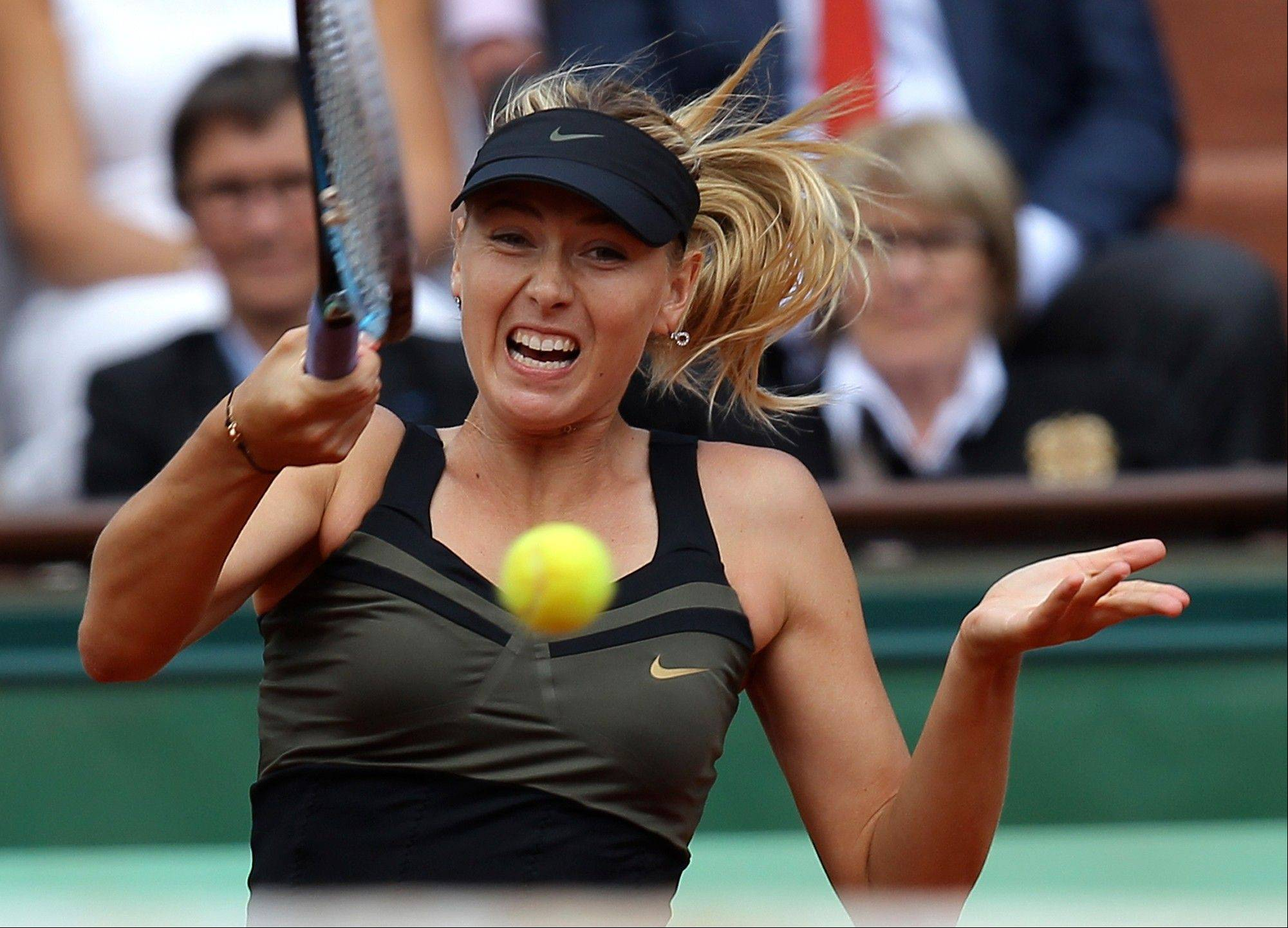 Russia's Maria Sharapova returns the ball to Italy's Sara Errani during their women's final match.