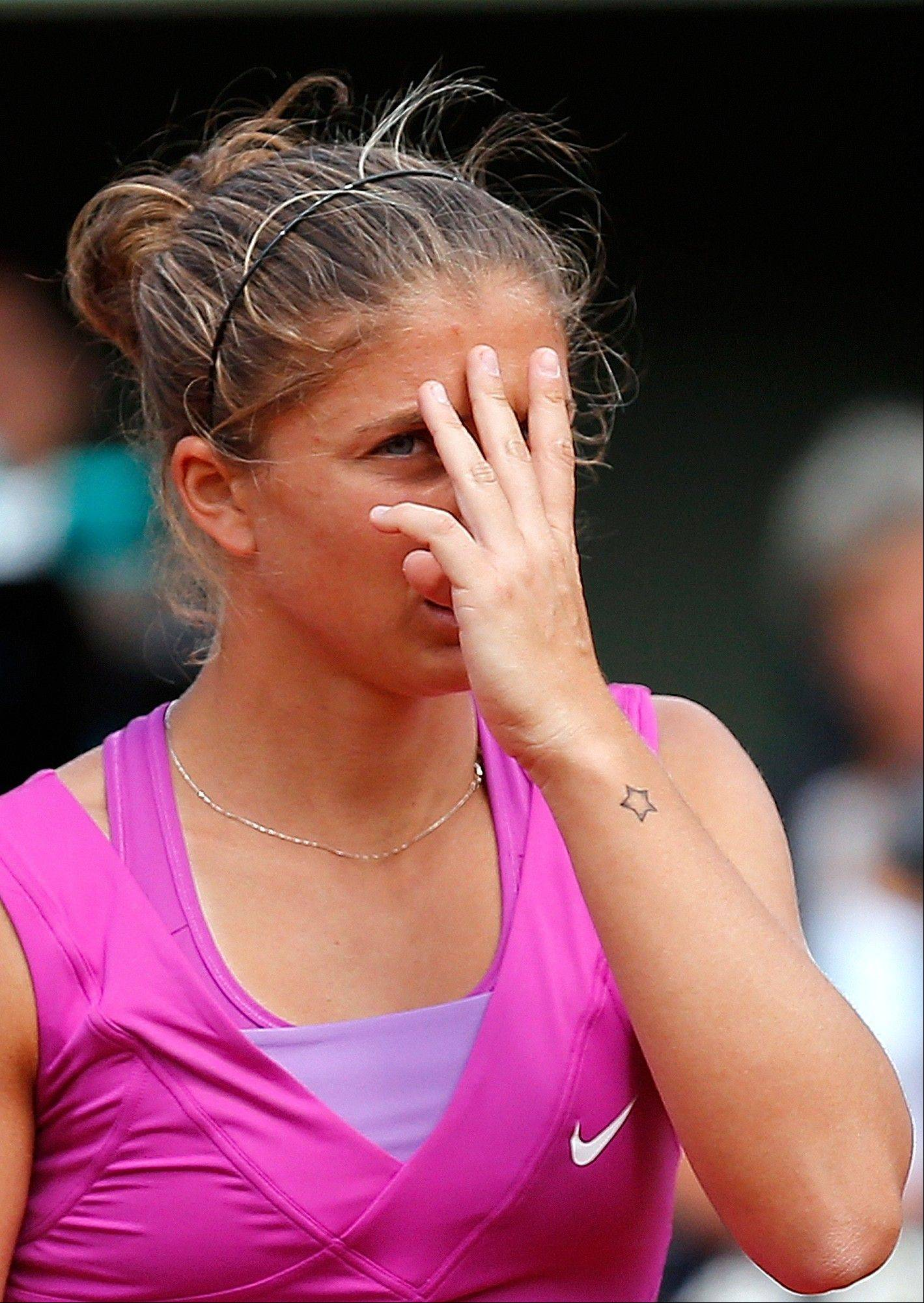 Sara Errani reacts as she plays Maria Sharapova.