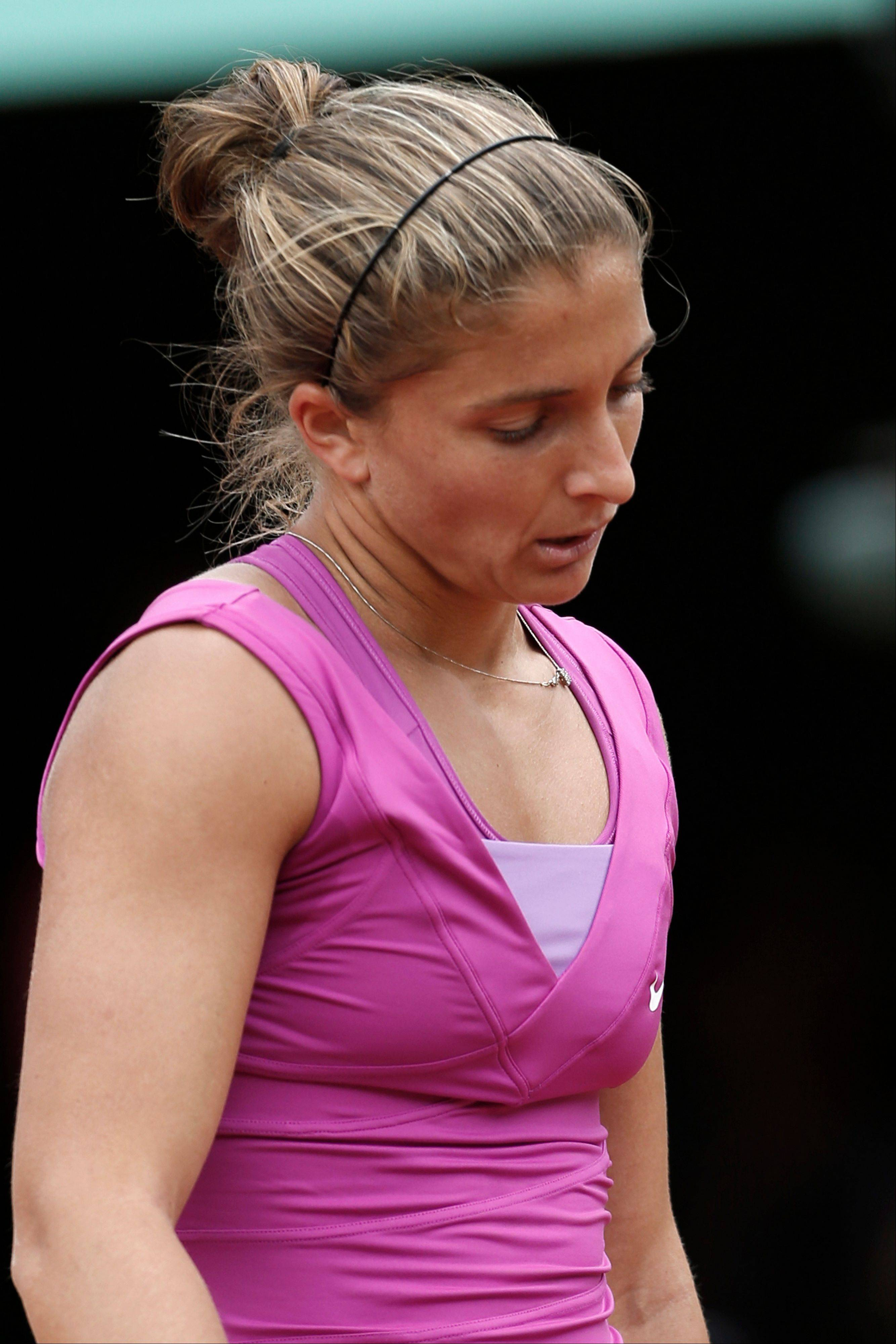 Sara Errani closes her eyes after missing a return.