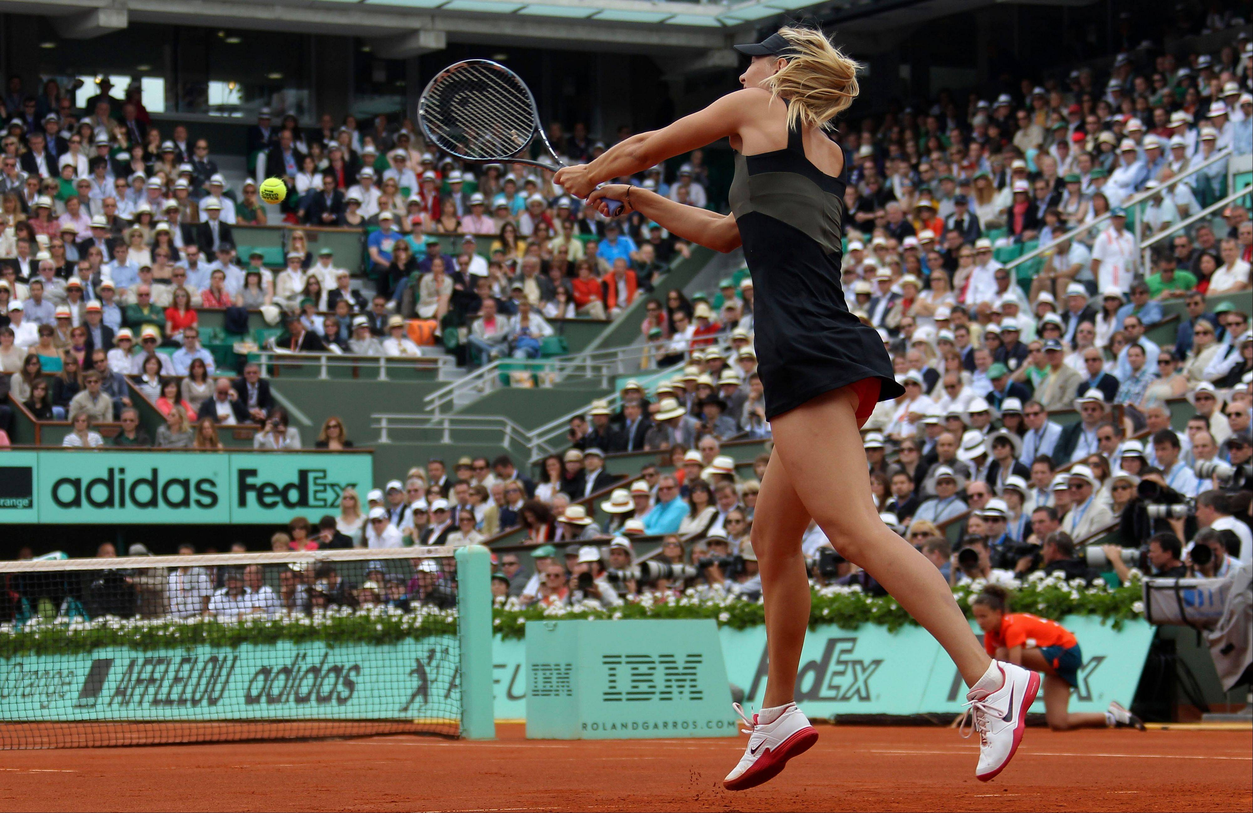 Maria Sharapova returns the ball to Sara Errani.