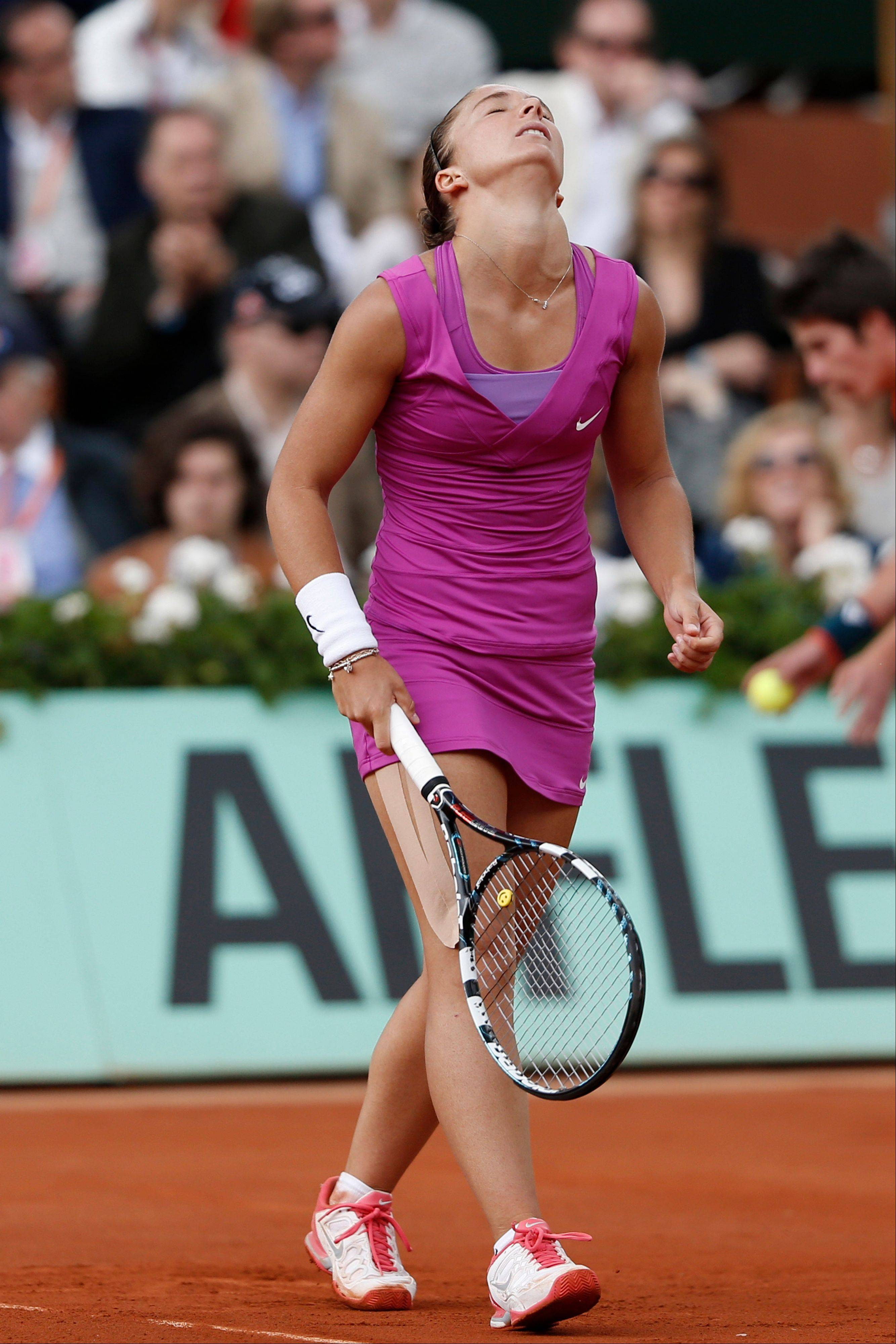 Sara Errani reacts after missing a return.