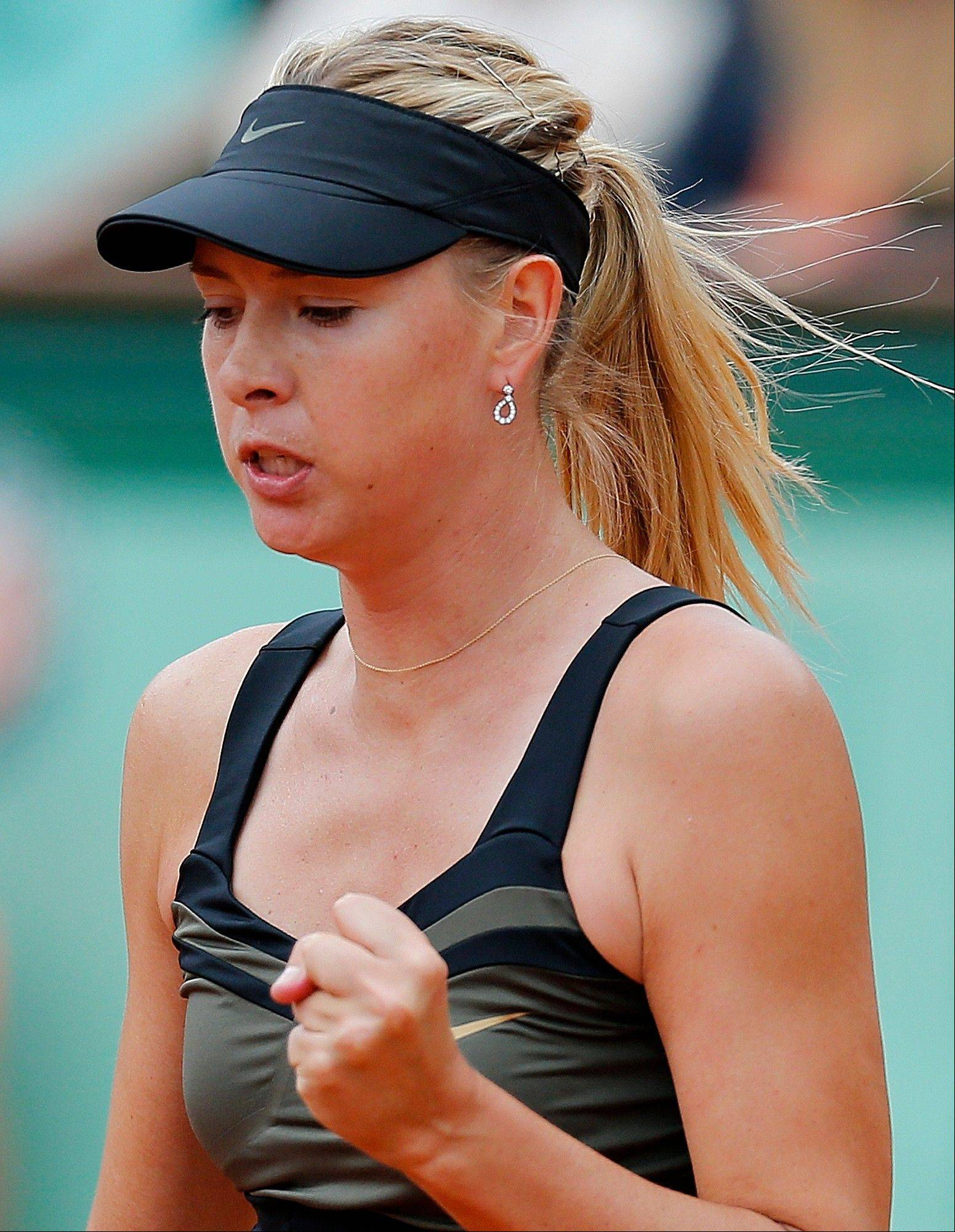 Maria Sharapova reacts after winning a point as she plays Sara Errani.