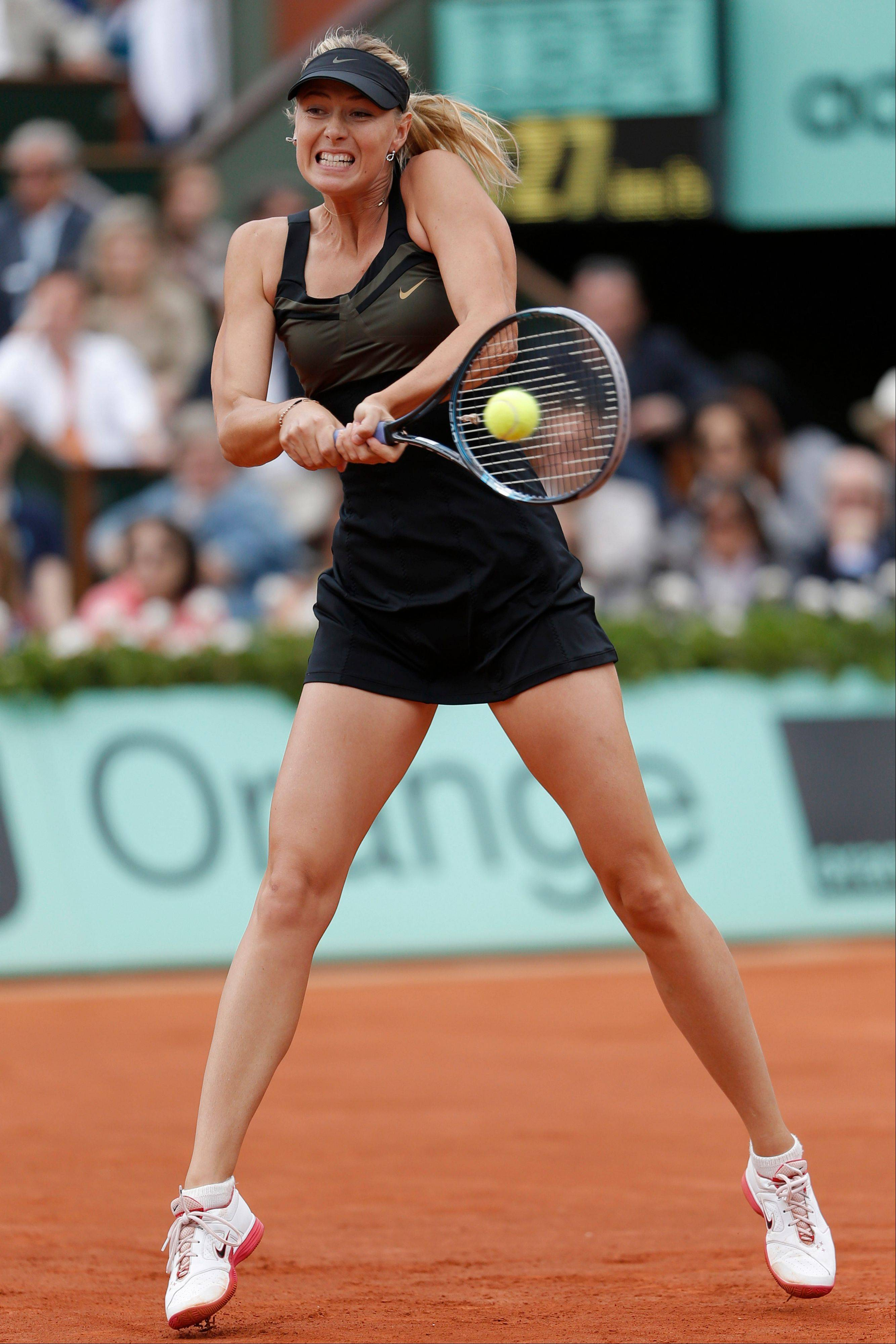 Maria Sharapova hits a return.
