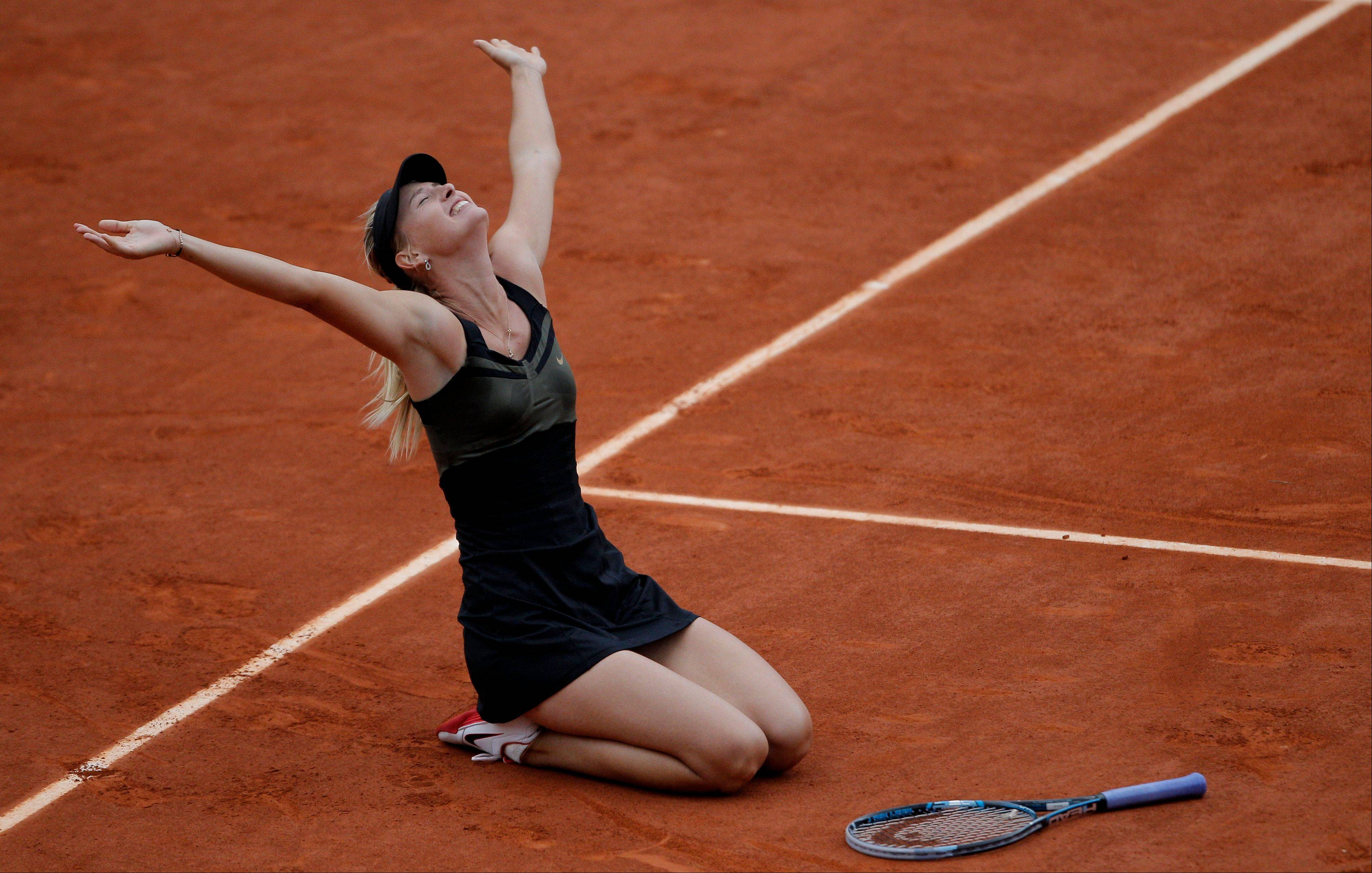 Maria Sharapova reacts as she defeats Sara Errani.