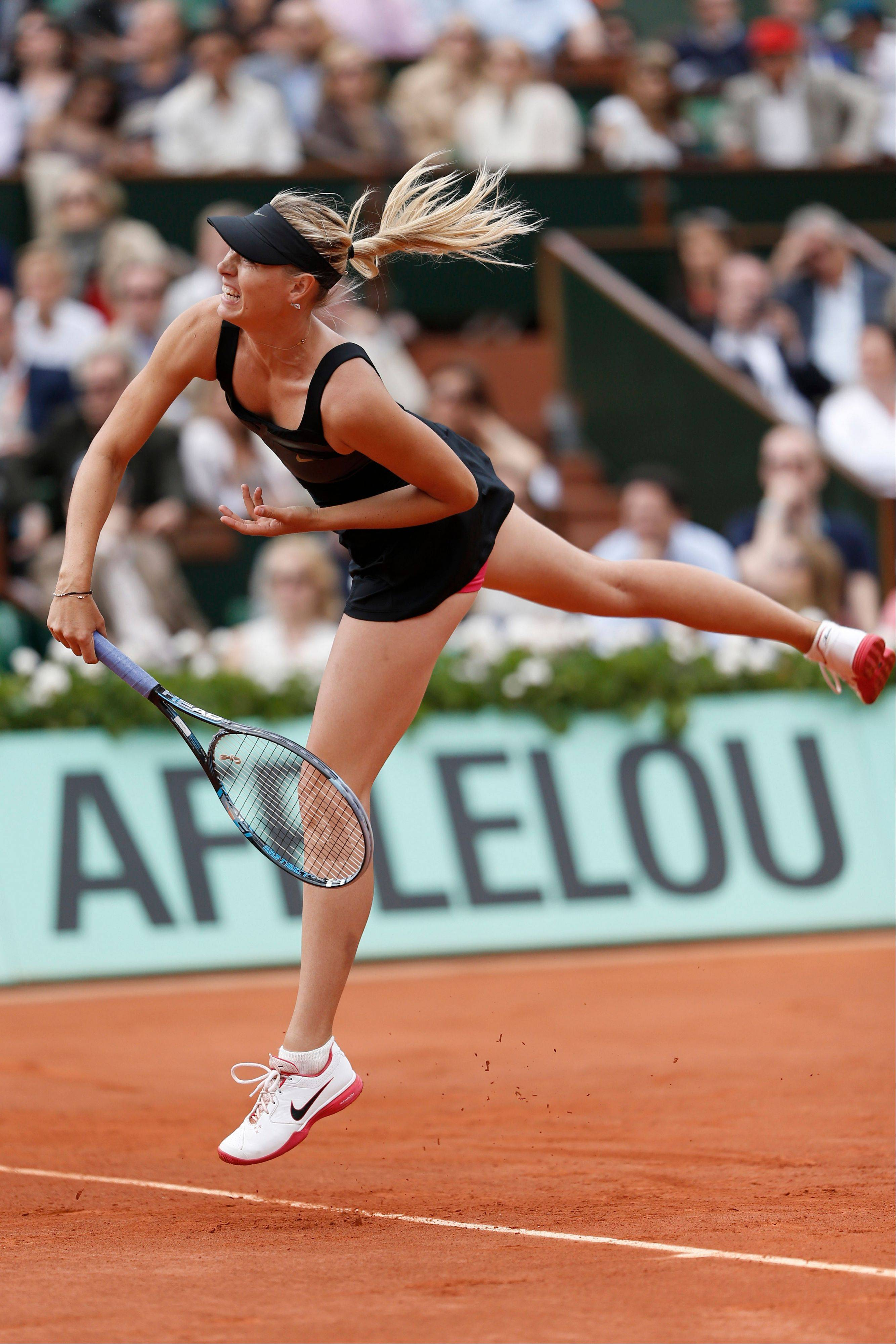 Maria Sharapova serves in the women's final match against Sara Errani.