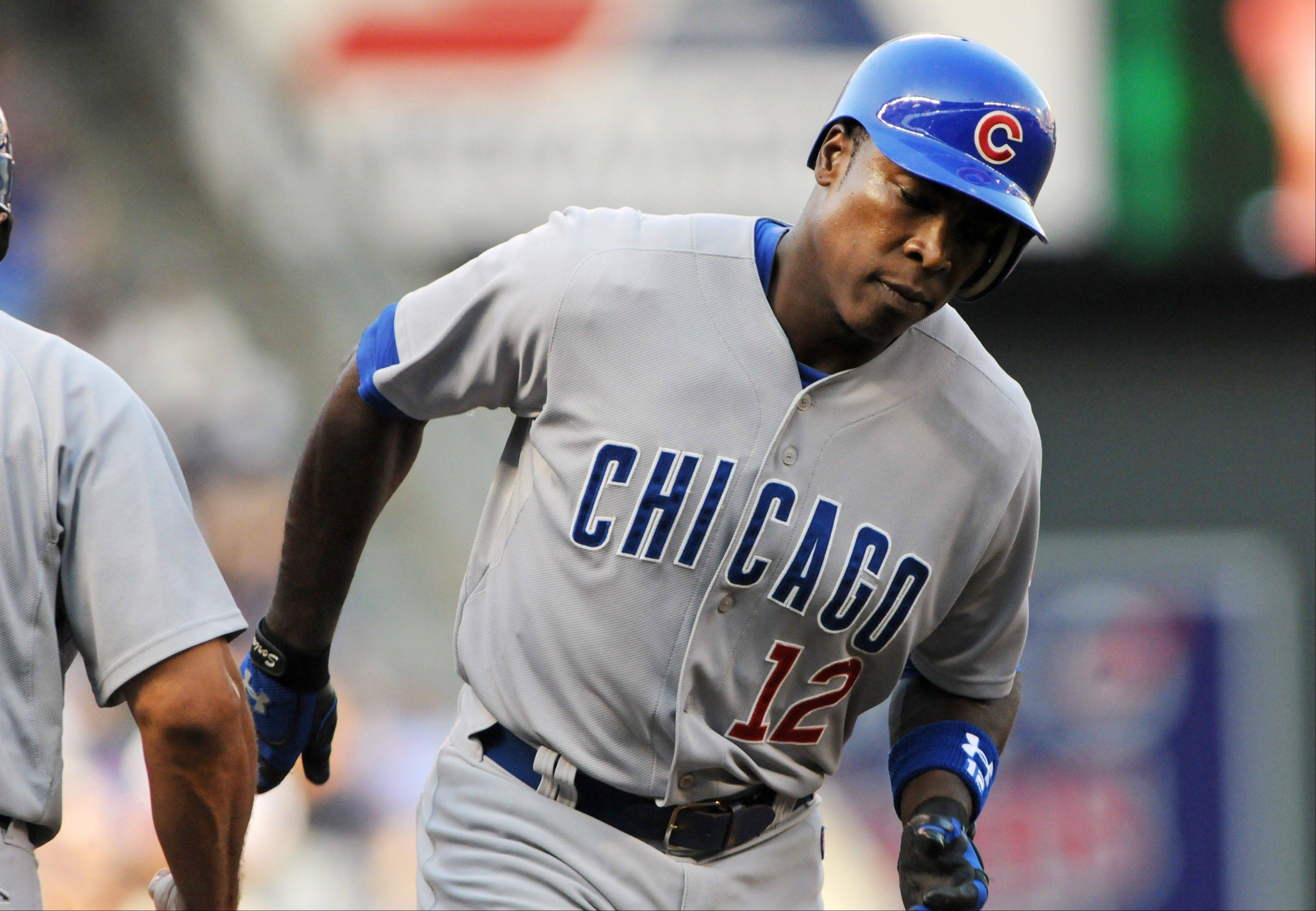 The Cubs' Alfonso Soriano rounds the bases Friday on his solo home run off Minnesota Twins pitcher P.J. Walters during the first inning in Minneapolis.