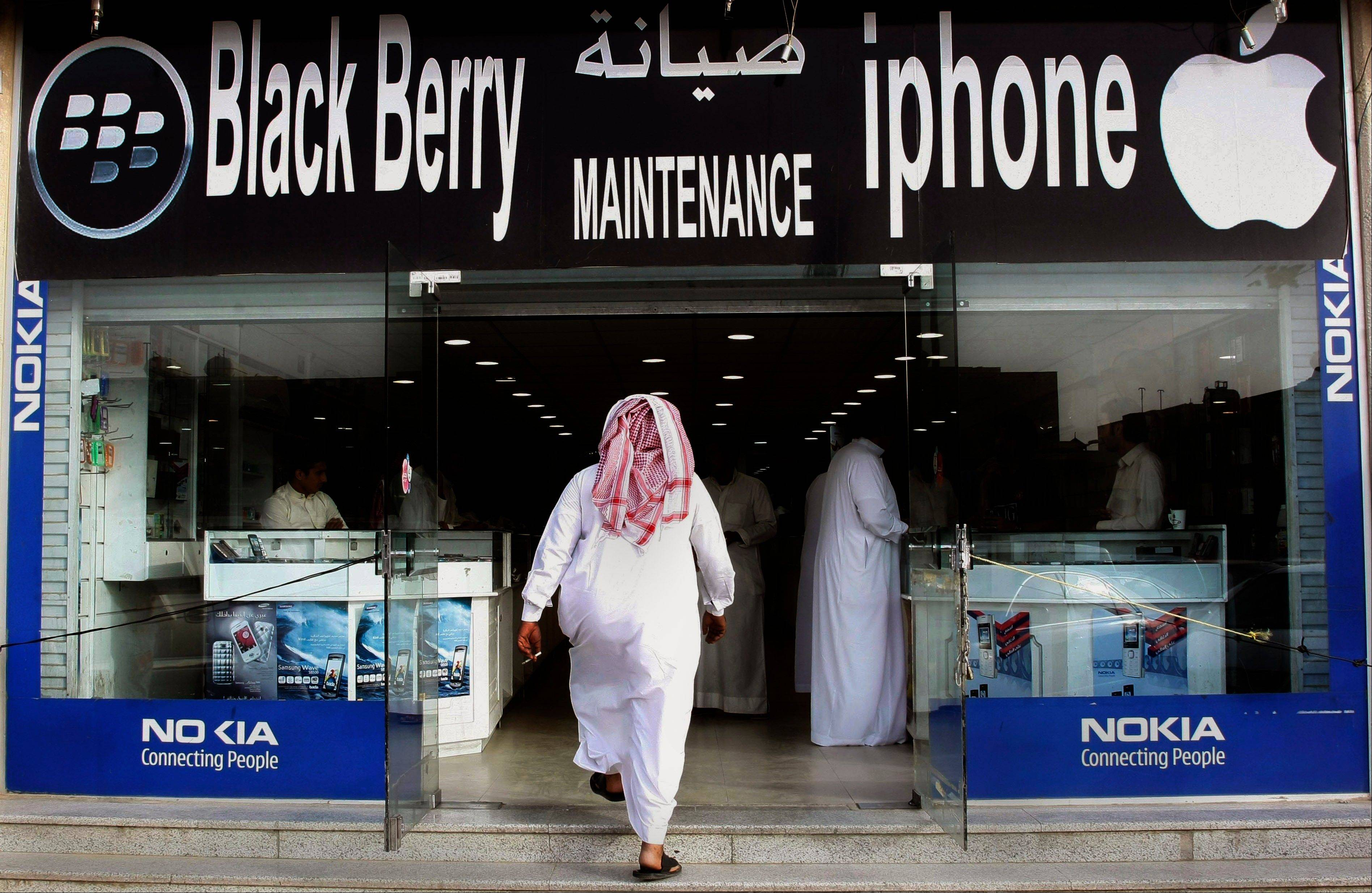 S man enters a mobile phone shop at a market in Riyadh, Saudi Arabia. There is talk that the fate of Research In Motion, the company that fathered the BlackBerry in 1999, is no longer certain as its flagship property rapidly loses market share to flashier phones like Apple's iPhone and Google's Android-driven models.