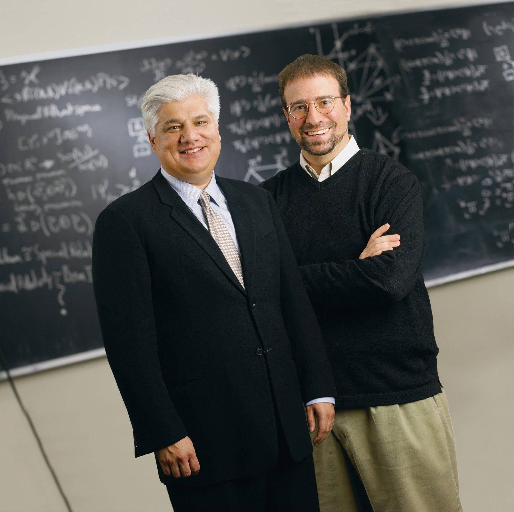 This undated photo provided by Perimeter Institute shows Mike Lazaridis, left, creator of BlackBerry, and Howard Burton, director of the Perimeter Institute in Waterloo, Ontario, Canada.