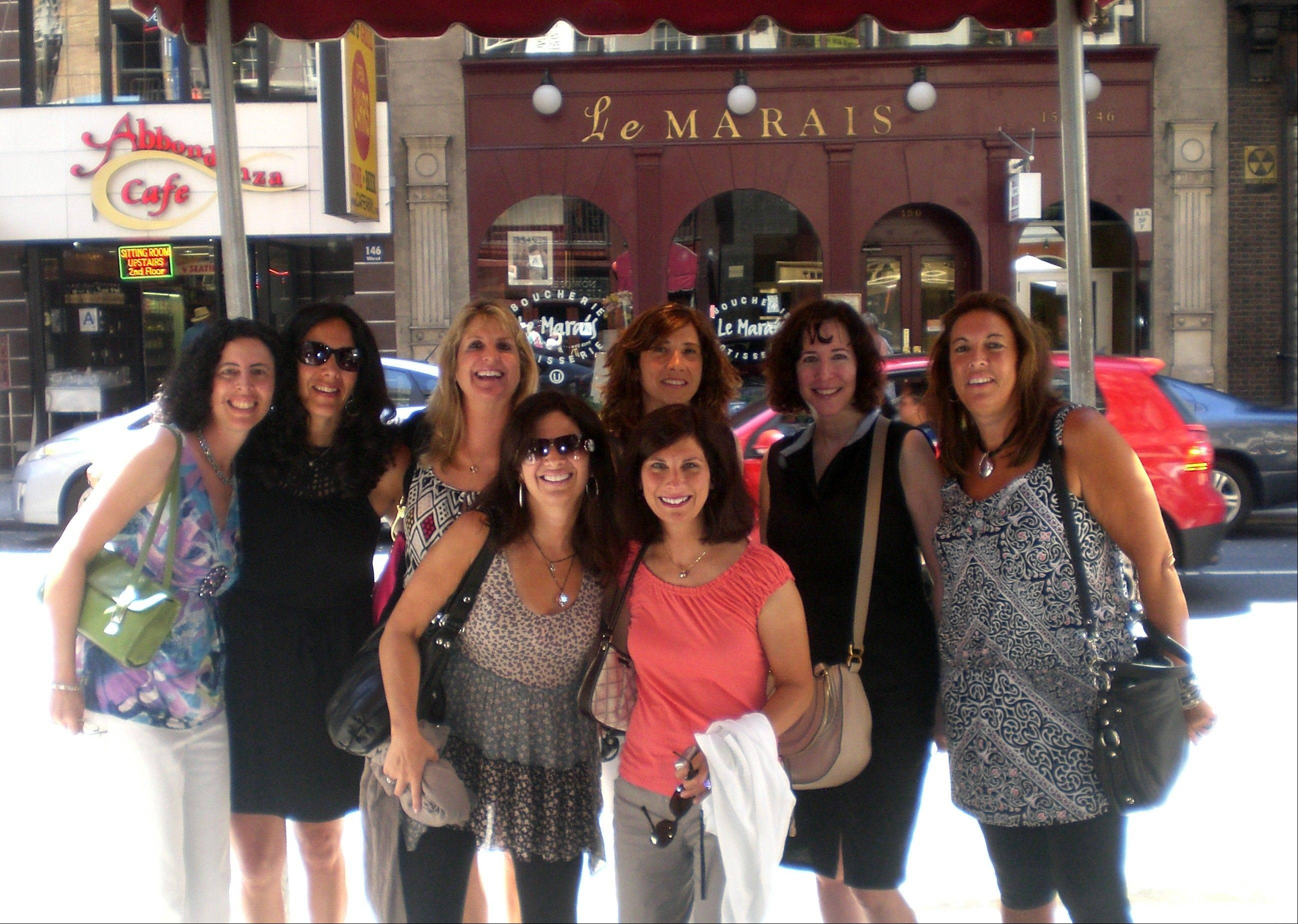 A group of friends -- back row from left, Susan Drechsler Rosenzweig, Laurie Stoller Birzon, Alice Sohne Meyer, Jodi Wechter Levy, Karen Silpe Morgenstern, Jill Hirschhorn Gordon and front row from left, Rhonda Sarter Gold and Sharon Stutman Miles -- celebrate in New York on July 30, 2011, after one of them proposed a reunion for their 50th birthday. Many baby boomers are marking milestone birthdays in a big way, with communal celebrations and elaborately planned parties.