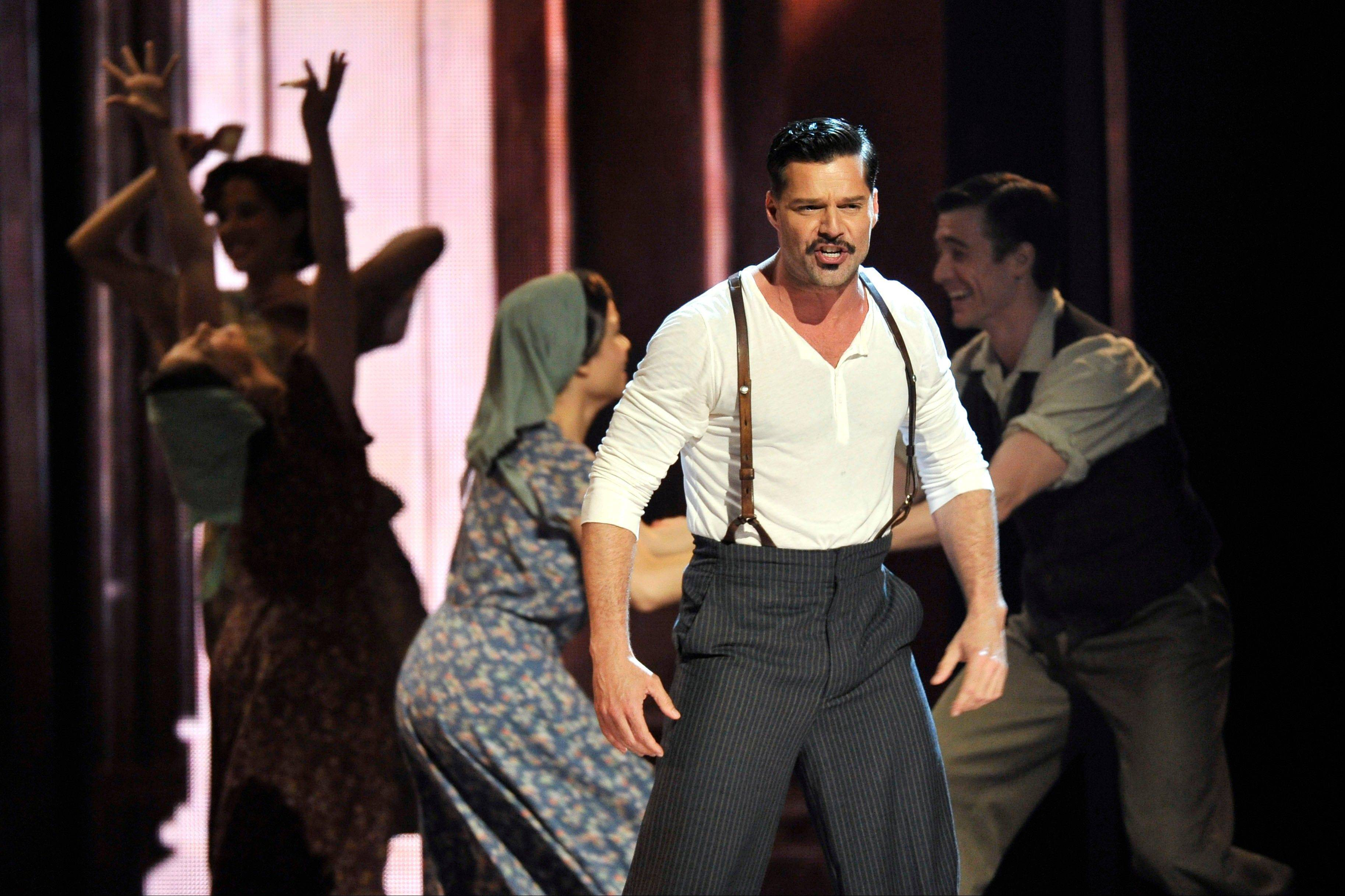 "Ricky Martin performs with the cast of ""Evita."""