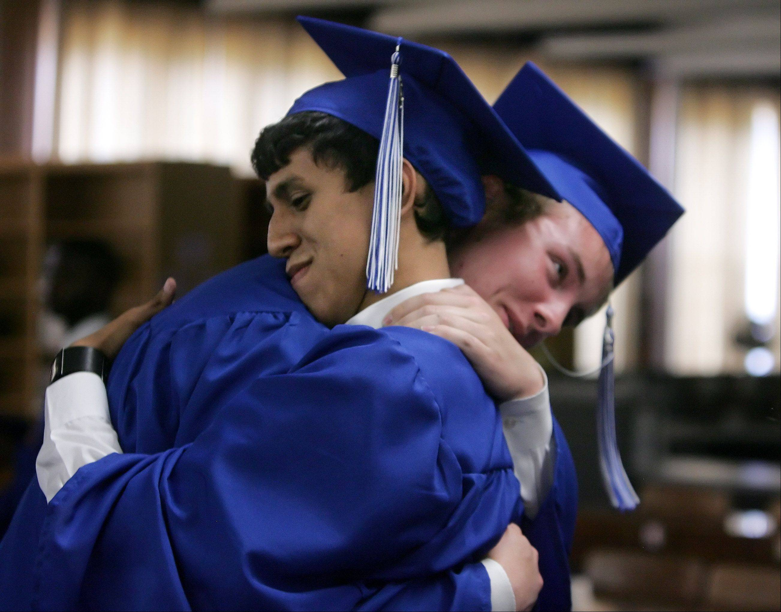 Graduates Mario Castro, left, hugs Joel Rushton before the graduation ceremony at Christian Liberty Academy in Arlington Heights Sunday. This year's graduating class consisted of 50 students.