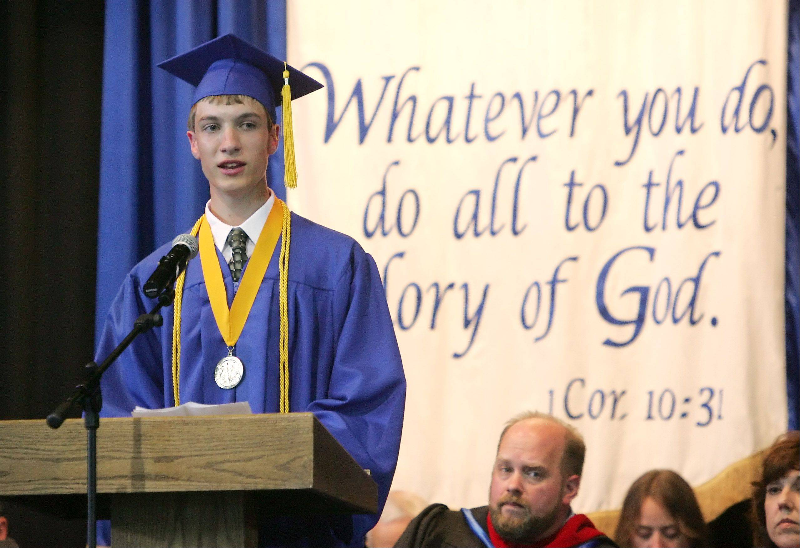 Andrew Johnson gives his valedictorian address during the graduation ceremony at Christian Liberty Academy in Arlington Heights Sunday. This year's graduating class consisted of 50 students.