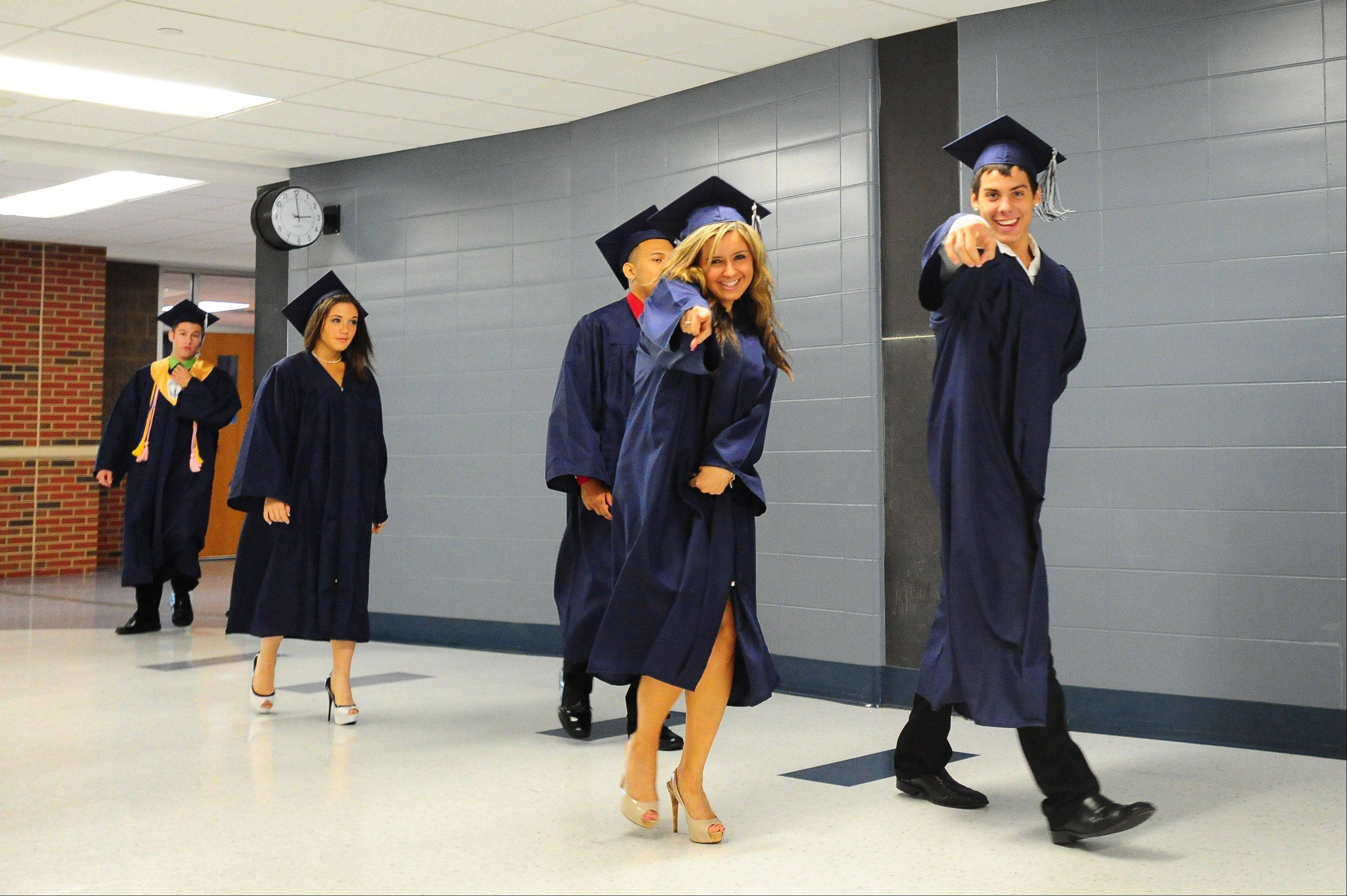 Rachael Capizzano and Thomas Caputo walk through the halls before entering the Addison Trail High School Class of 2012 Commencement on Sunday
