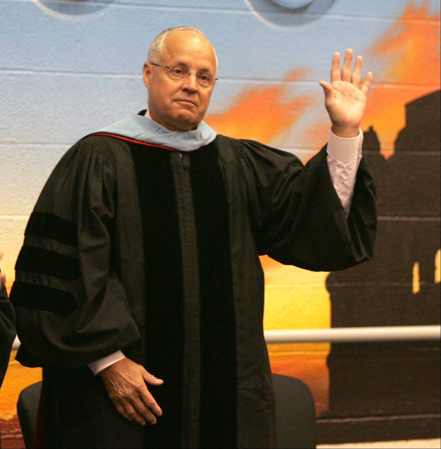 Retiring District 88 Superintendent Dr. Steve Humphrey waves to his last Willowbrook High School graduation.