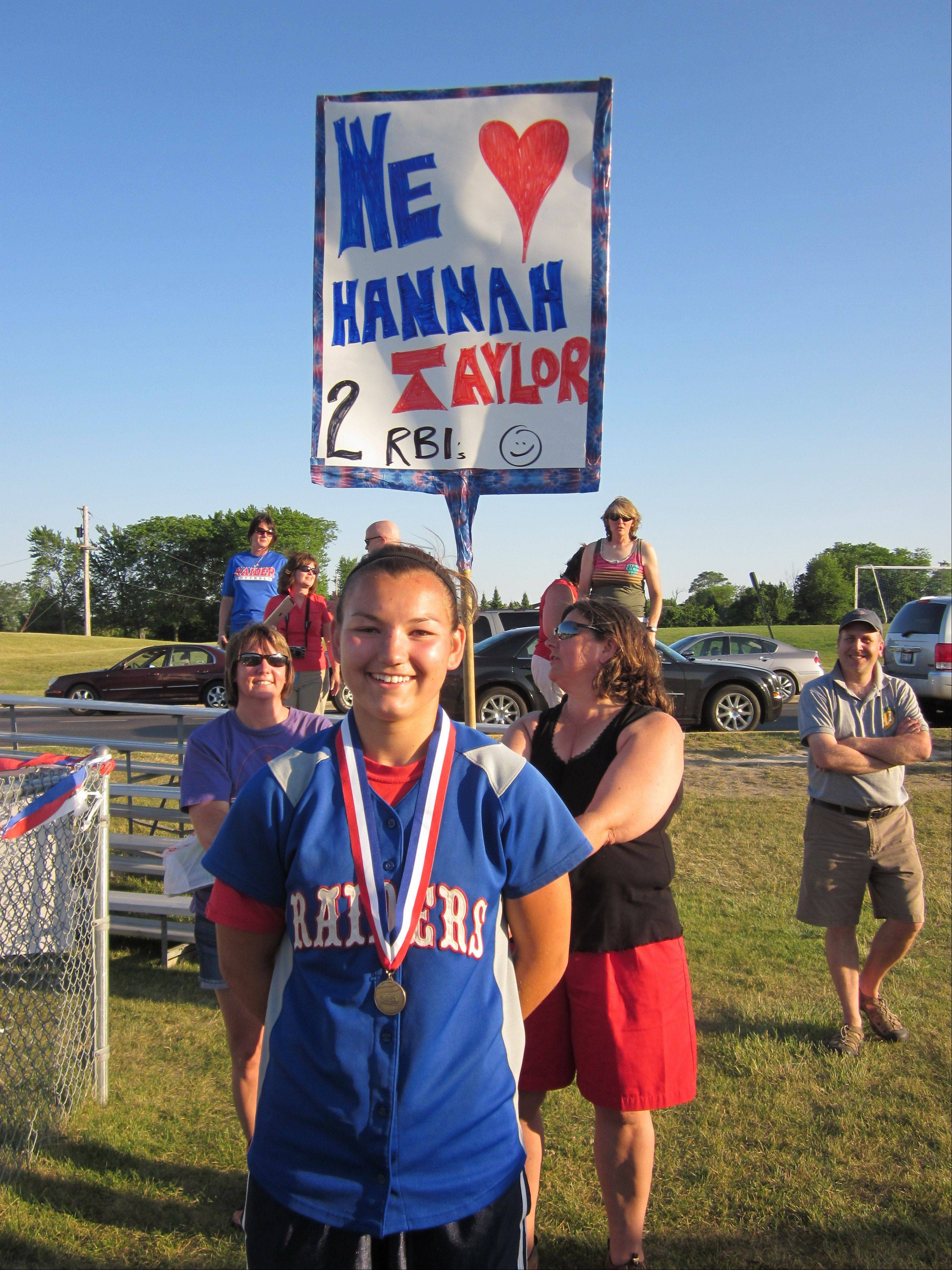Hannah Taylor, who drove in the two runs the Raiders needed to win the state softball title, was honored on a poster her aunt made.