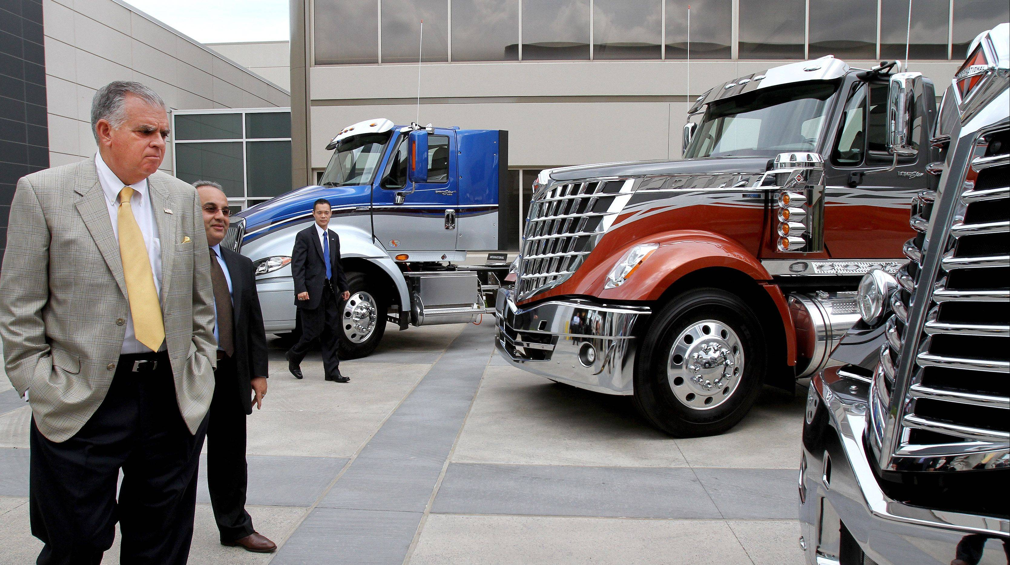 U.S. Transportation Secretary Ray LaHood, left, checks out the latest inventory of trucks as he visits Navistar in Lisle on Monday. To his right is Ramin Younessi, group vice president of product development.