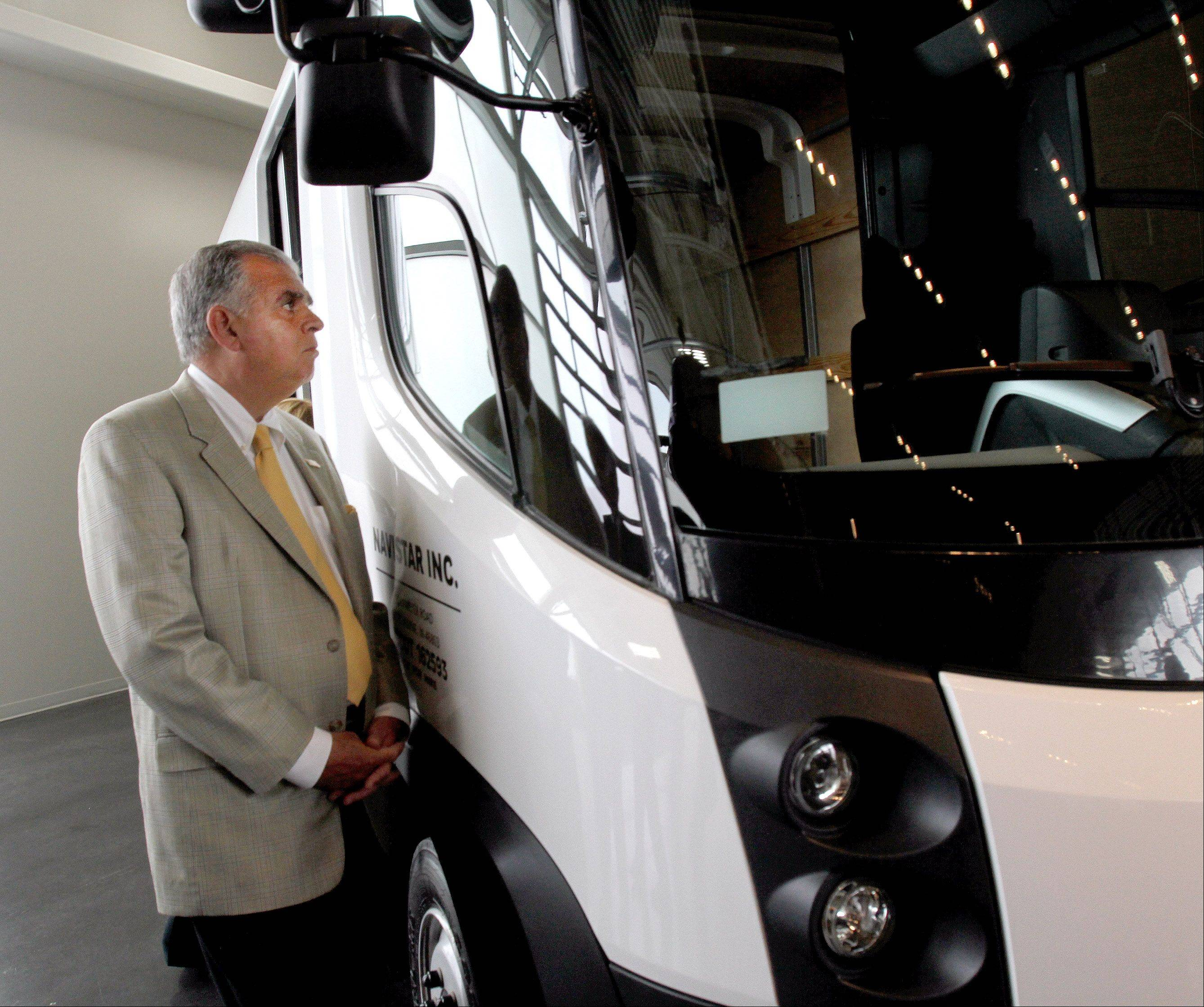 U.S. Transportation Secretary Ray LaHood takes a look inside an electric van during a visit to Navistar in Lisle on Monday.