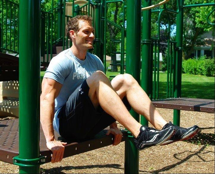 Modified knee-up: Sit on a bench, lean back slightly and tuck your knees to your chest.