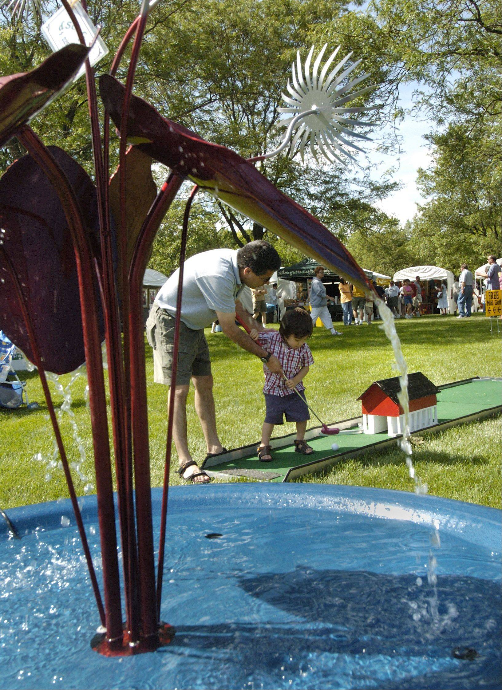 Cantigny's Art in Bloom festival over Father's Day weekend lets dads and kids indulge in a little family time amid the variety of art pieces.