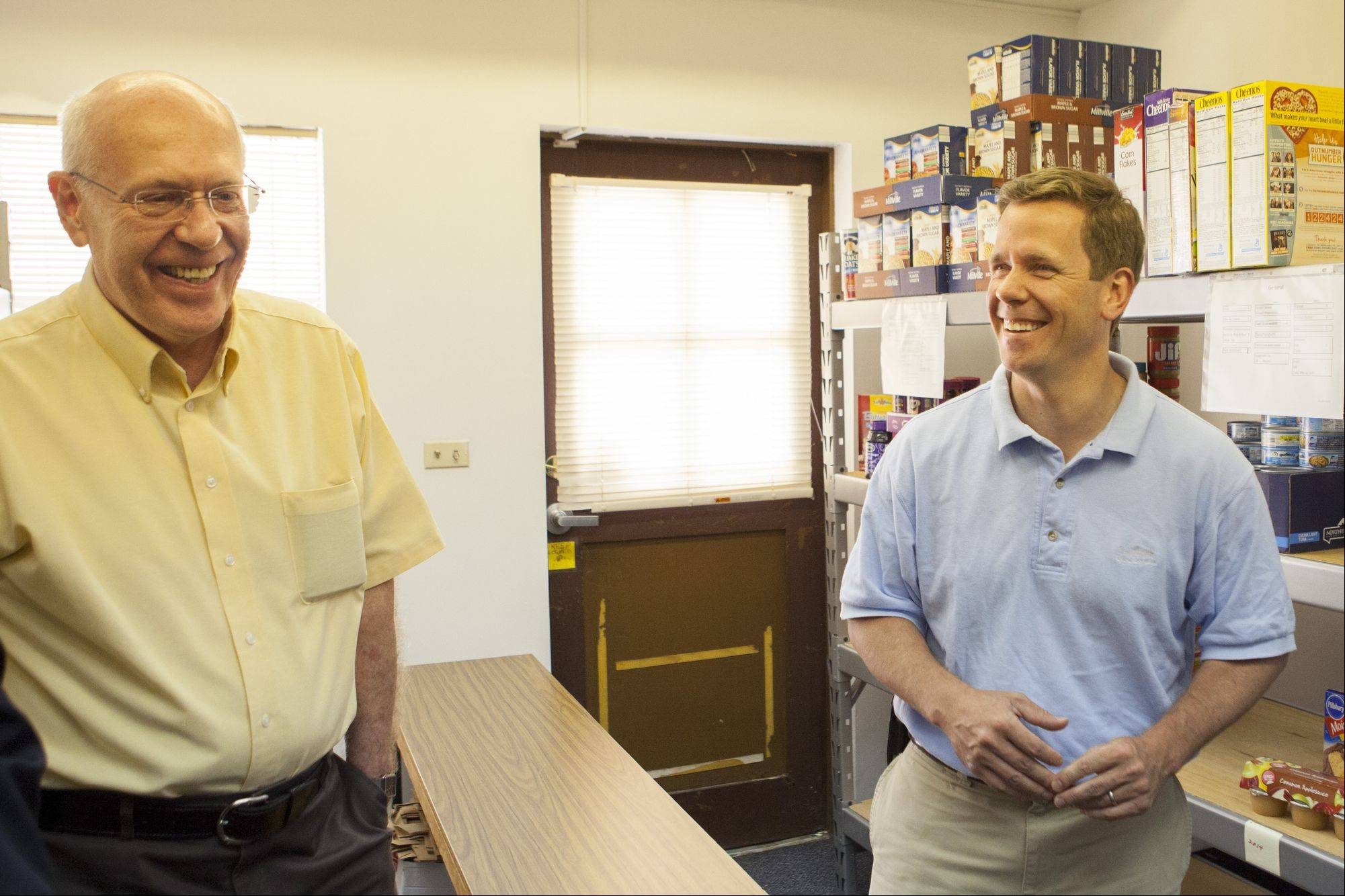 Jim Bradley talks to Congressman Bob Dold about the food and support they are getting for the Wheeling Food Pantry, which opened in September.