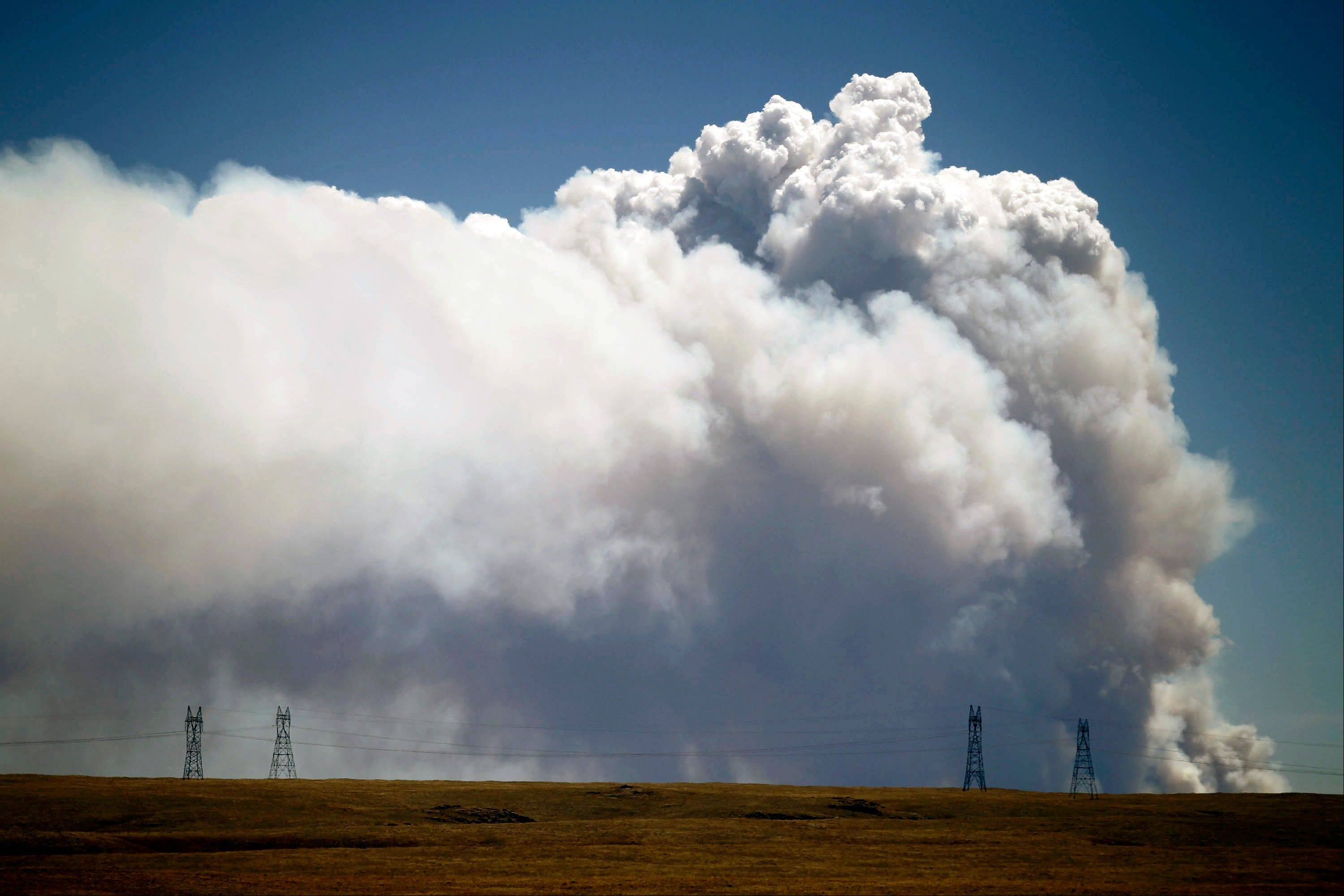 Smoke is visible from Tie Siding, Wyo., as a wildfire burns northwest of Fort Collins, Colo., on Saturday, June 9, 2012. The cause of the fire is not yet known.