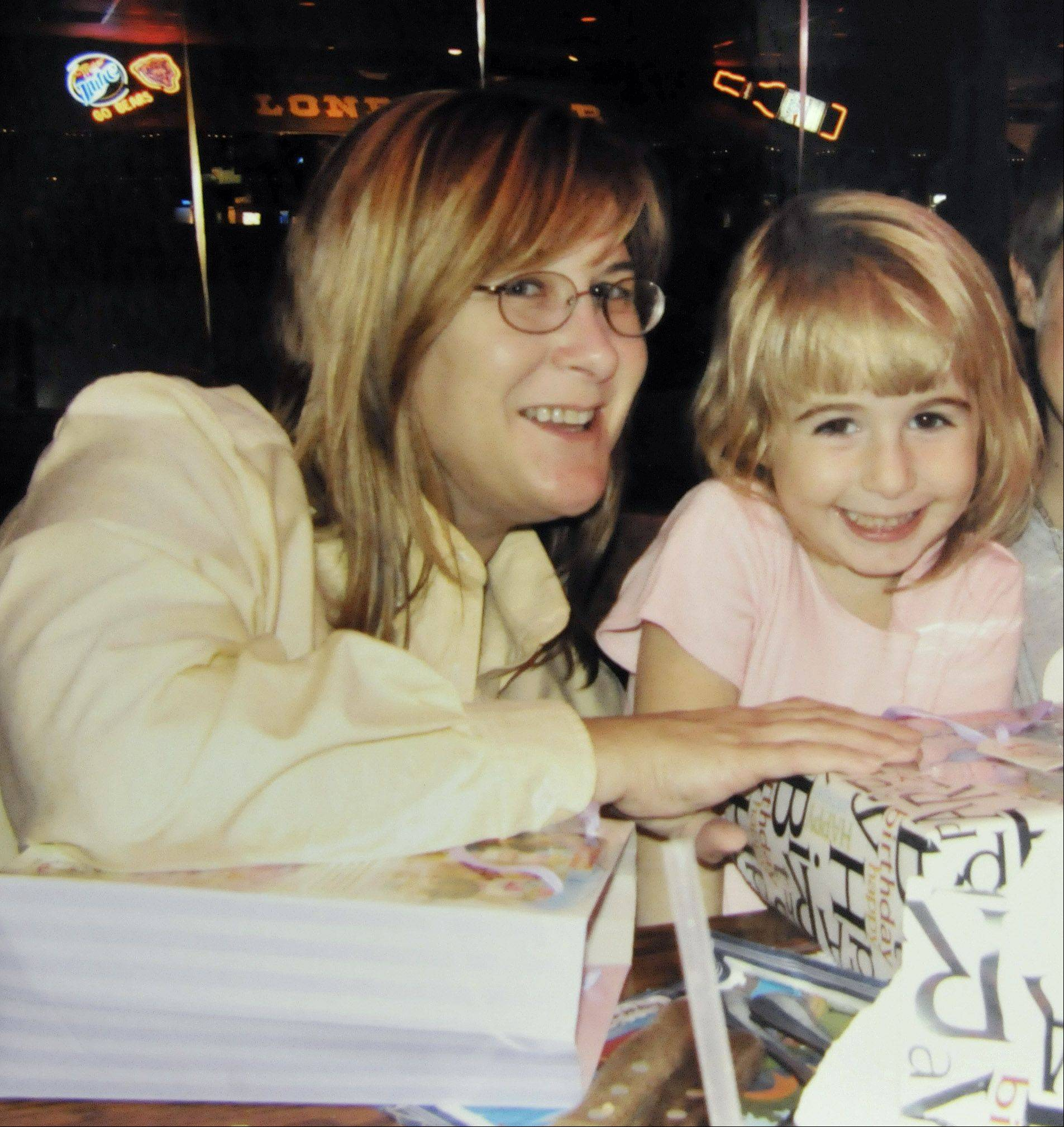 Marci and Maggie Webber celebrate Maggie's fourth birthday at an Elgin restaurant about a month before the child was slain.